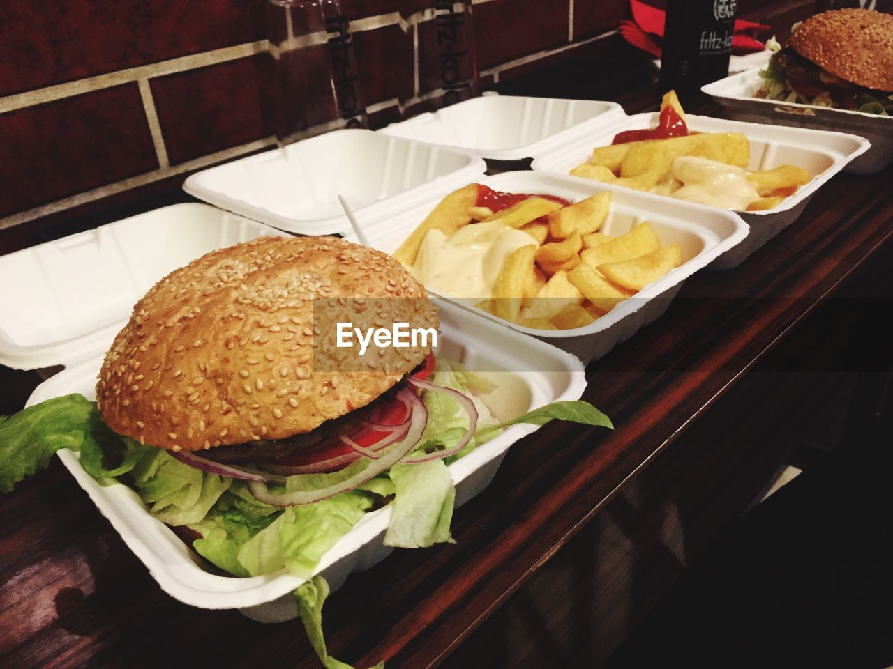 High angle view of hamburger with fries served in table