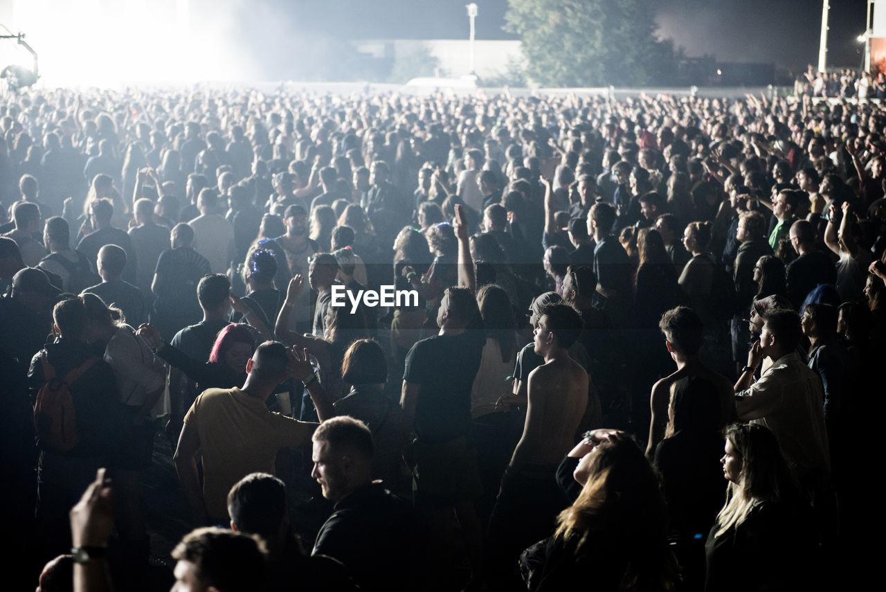 Crowd enjoying at music concert