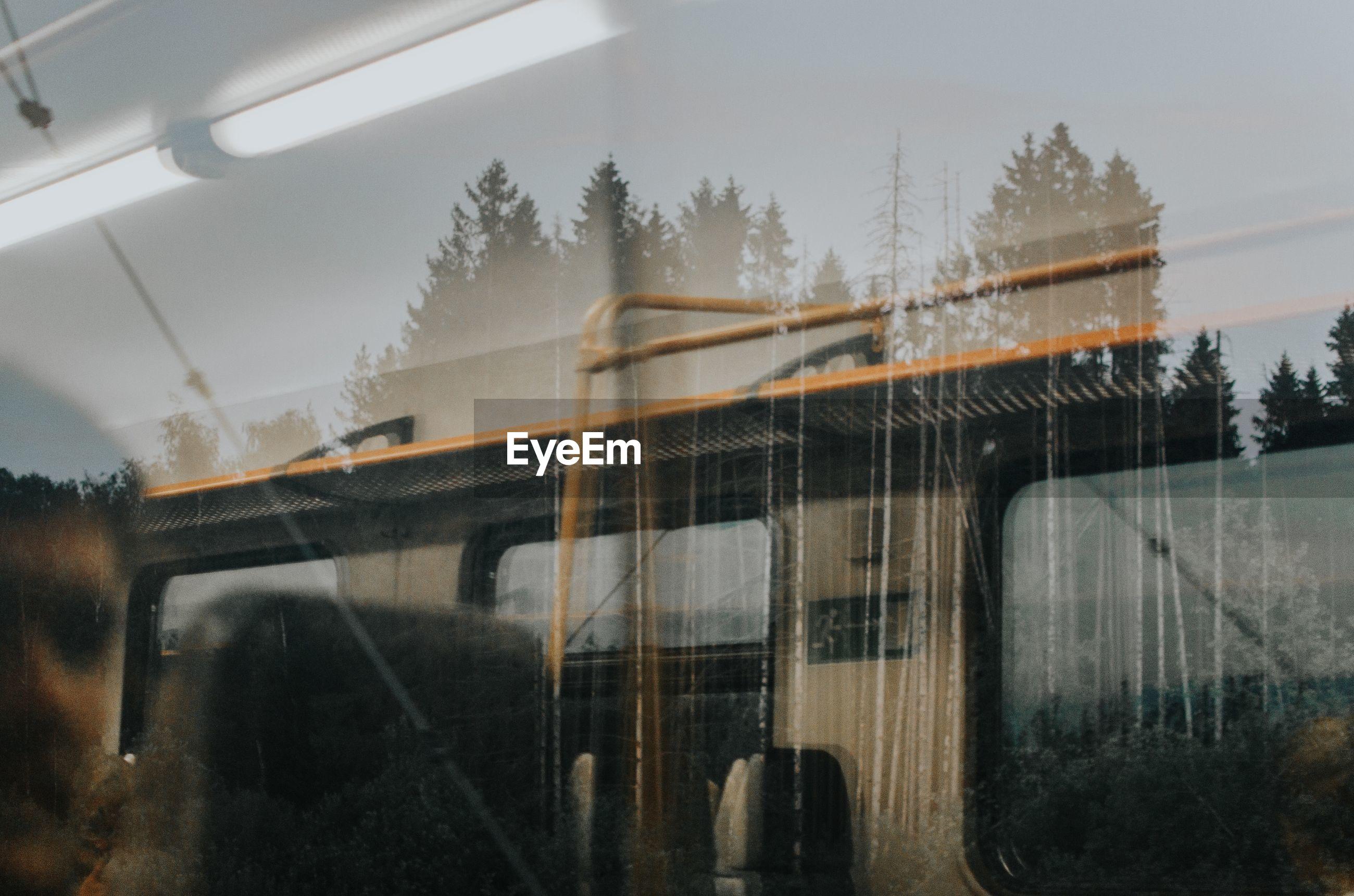 TRAIN ON RAILROAD TRACK SEEN THROUGH WINDSHIELD