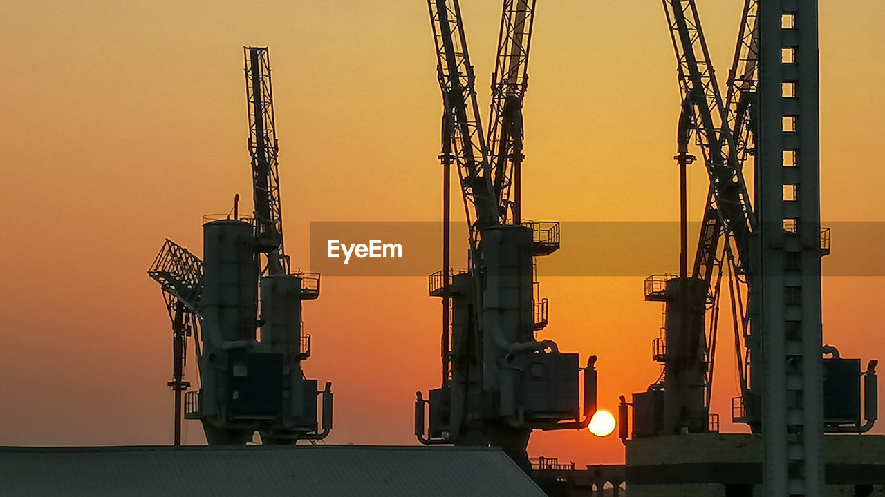 sky, sunset, industry, architecture, development, machinery, no people, orange color, crane - construction machinery, built structure, construction industry, nature, outdoors, construction site, metal, building exterior, low angle view, silhouette, incomplete, clear sky, construction equipment