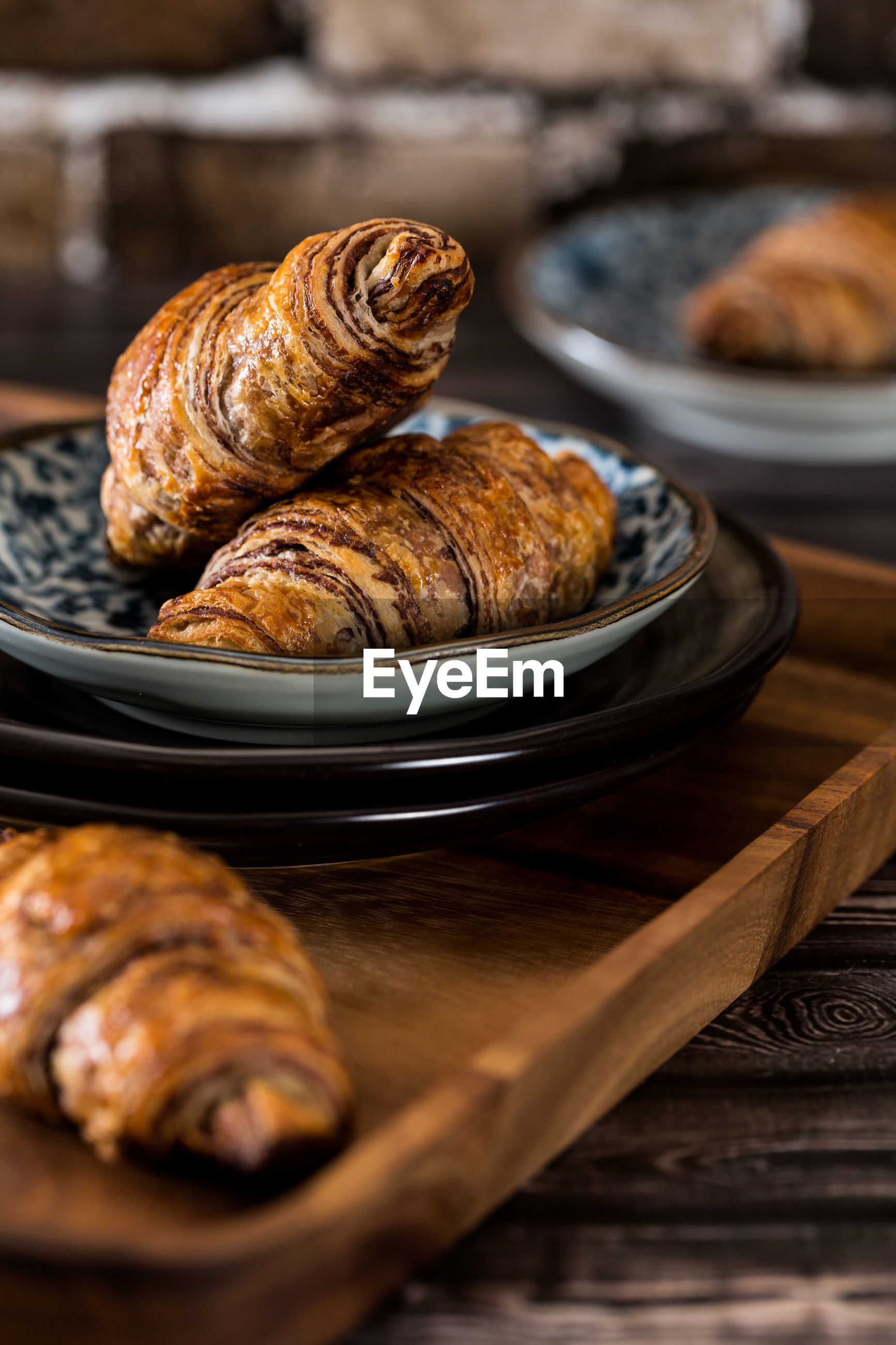 Close-up of chocolate croissant in plate on table