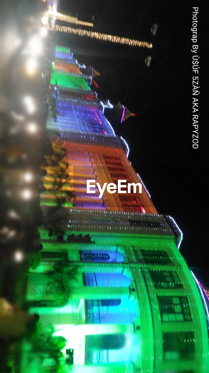 illuminated, night, celebration, building exterior, christmas, green color, christmas lights, built structure, no people, architecture, christmas decoration, low angle view, multi colored, neon, city, gambling, outdoors, close-up