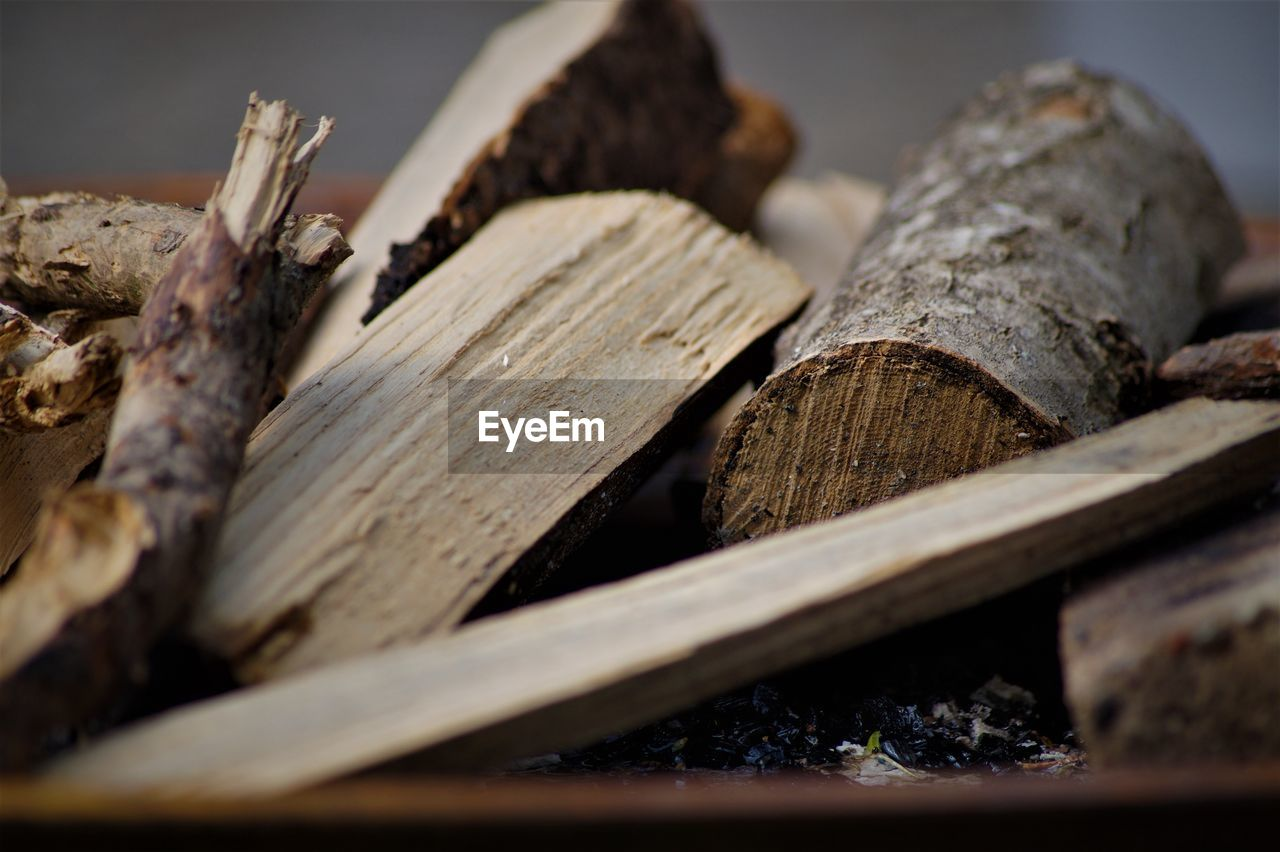 wood - material, selective focus, close-up, still life, no people, log, stack, wood, tree, large group of objects, heap, timber, abundance, food, food and drink, fuel and power generation, indoors, textured, nature, brown