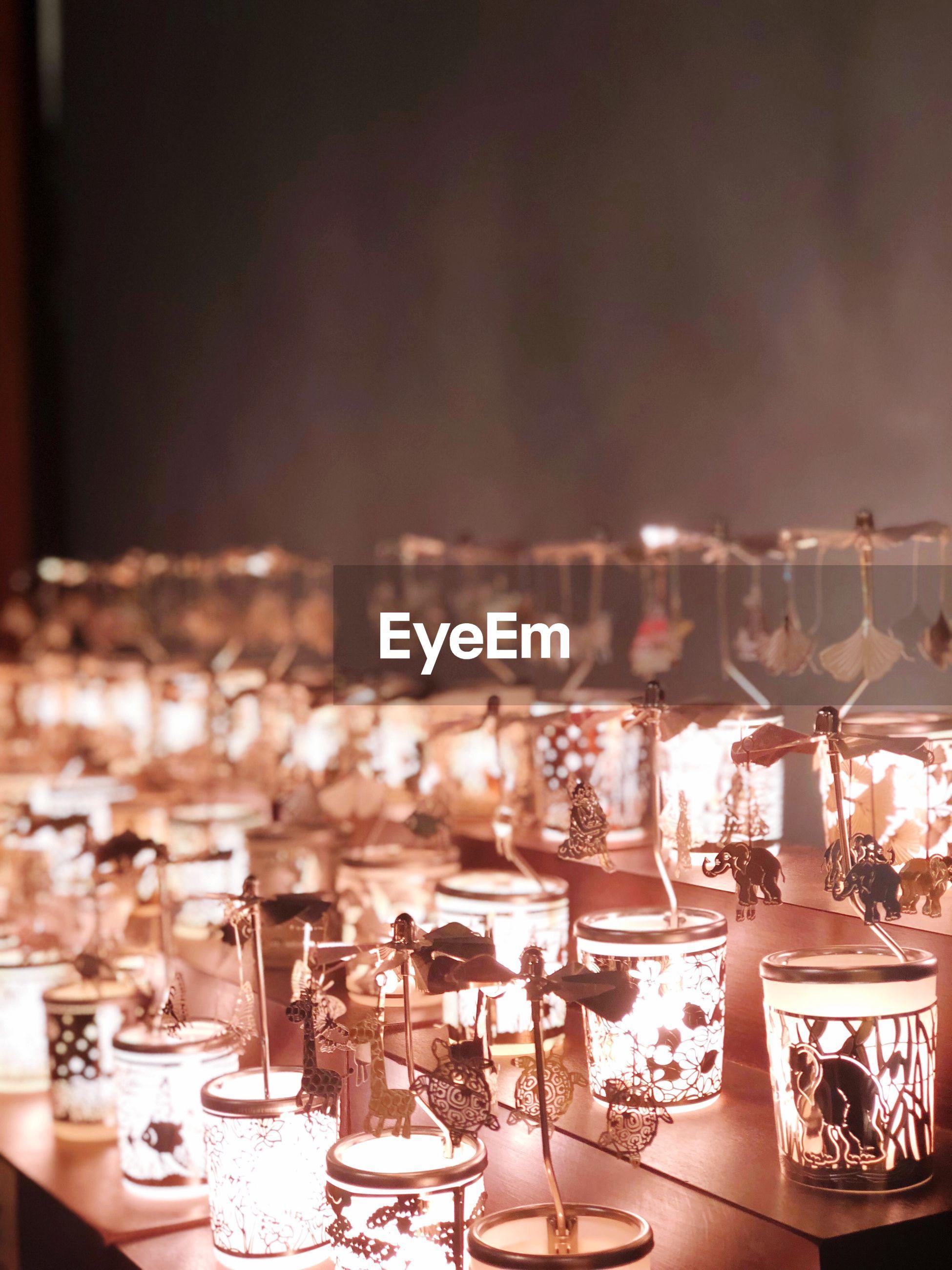 Close-up of illuminated lanterns on table
