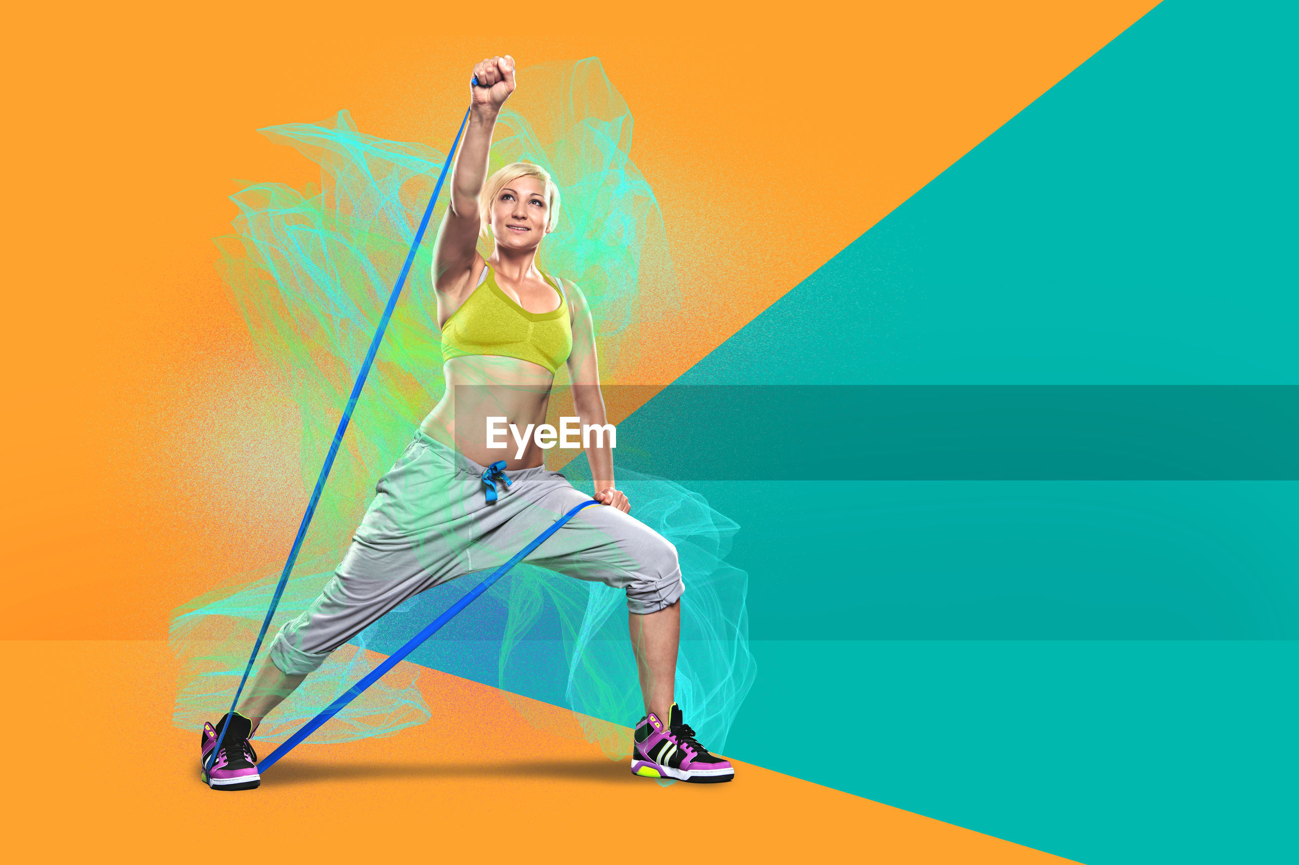 Digital composite image woman dancing against colored background