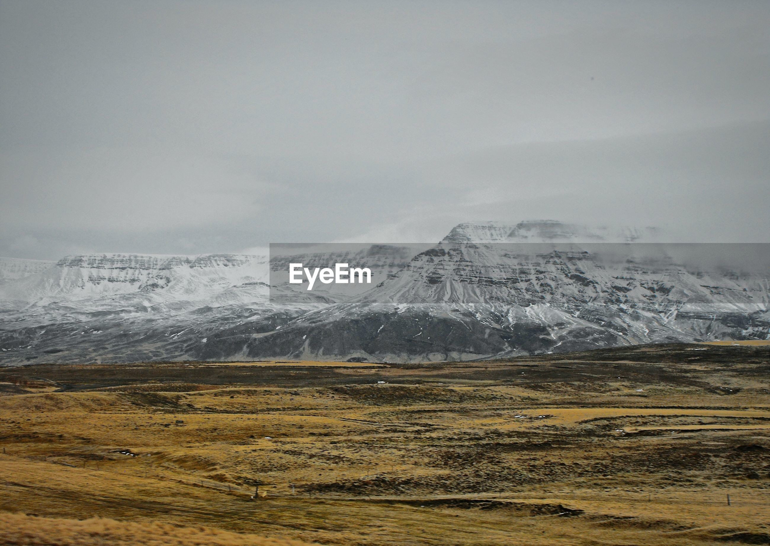 Barren landscape with magnificent rock formations in background