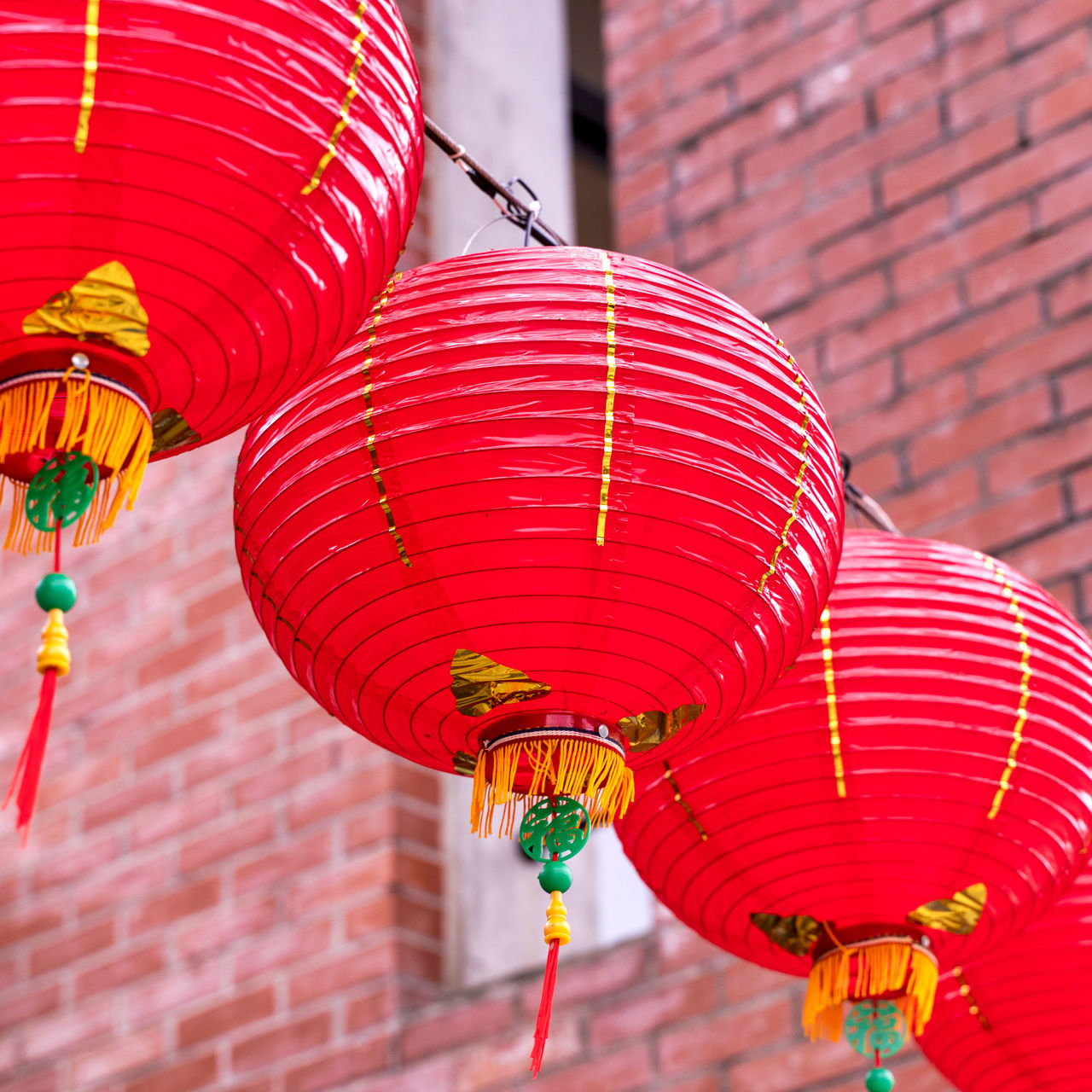 LOW ANGLE VIEW OF LANTERNS HANGING ON BUILDING