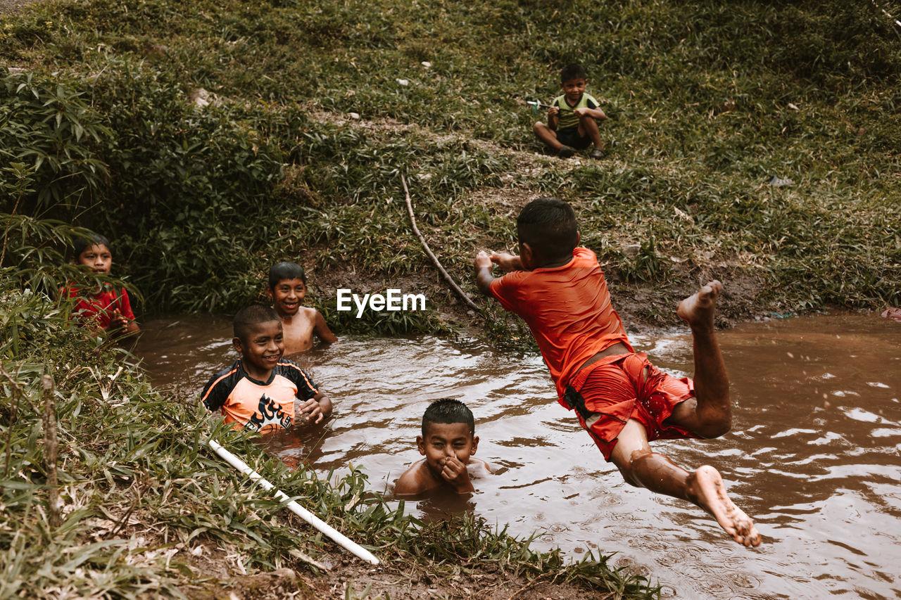CHILDREN SITTING ON LAND