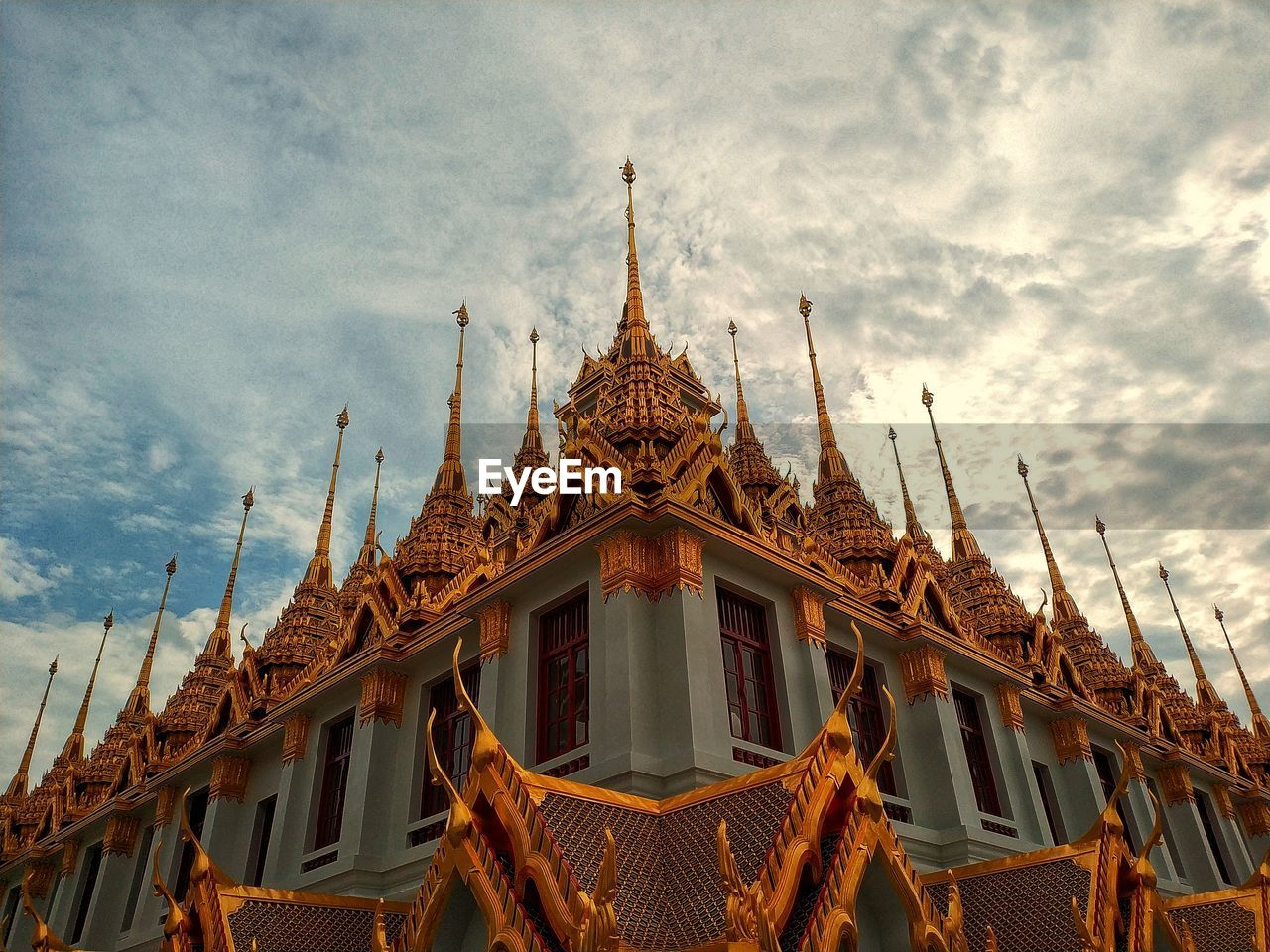 LOW ANGLE VIEW OF TEMPLE AGAINST BUILDING AND SKY