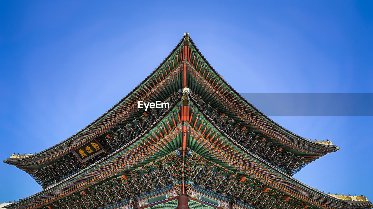 built structure, low angle view, architecture, sky, blue, building exterior, no people, clear sky, building, nature, belief, place of worship, religion, roof, day, spirituality, high section, travel destinations, history, outdoors, ornate