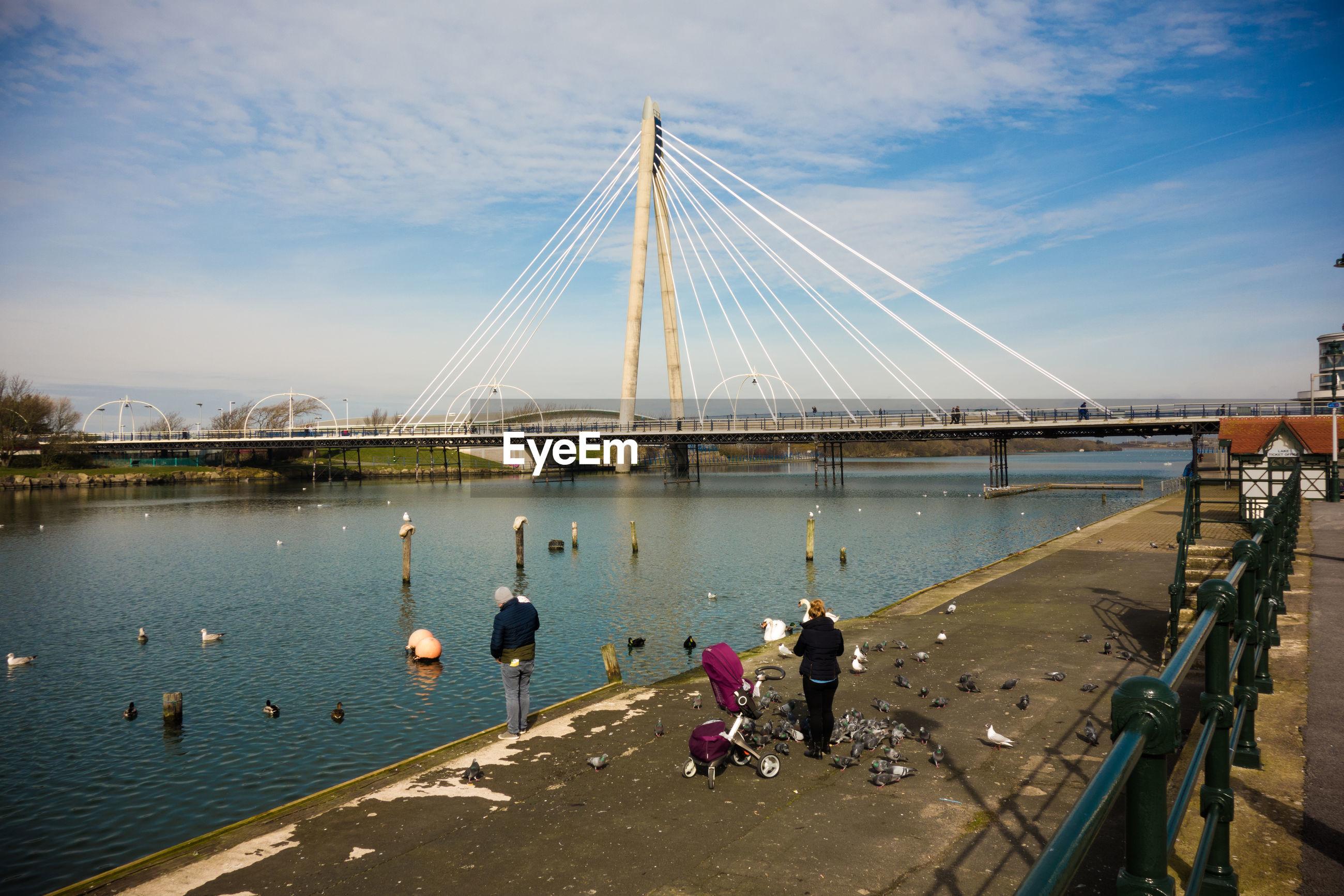 Marine way bridge over river against sky