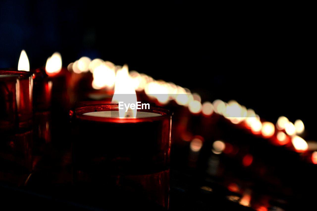 Close-Up Of Burning Tea Light At Night