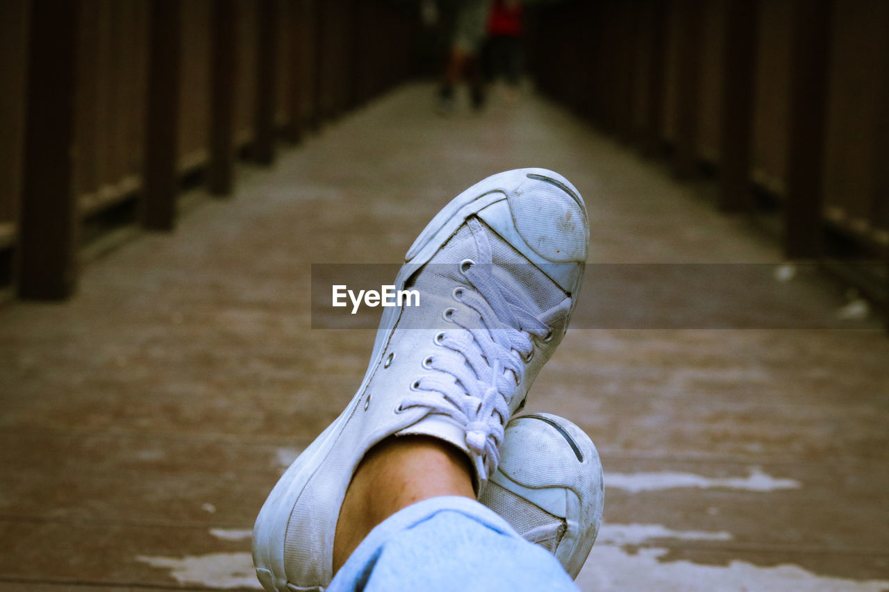 human body part, real people, shoe, low section, human leg, body part, one person, lifestyles, personal perspective, focus on foreground, day, unrecognizable person, jeans, men, leisure activity, standing, footpath, casual clothing, child, outdoors, human foot, human limb