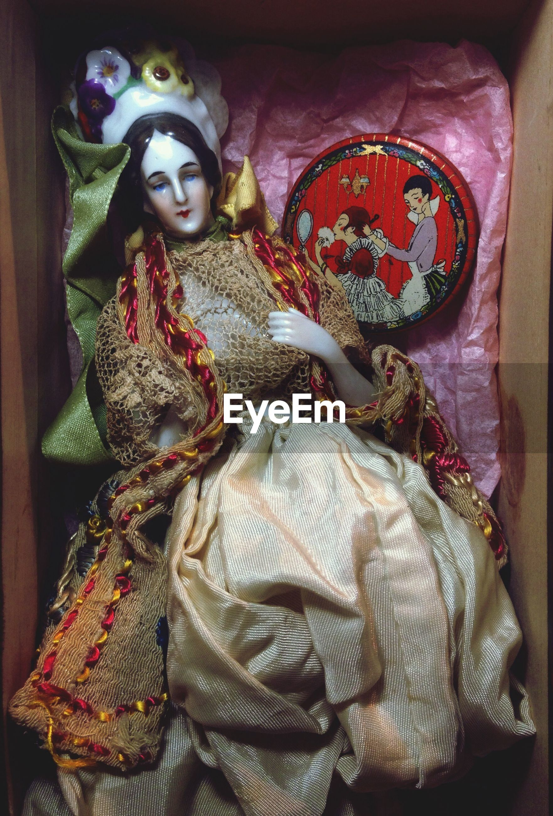 High angle view of doll in box