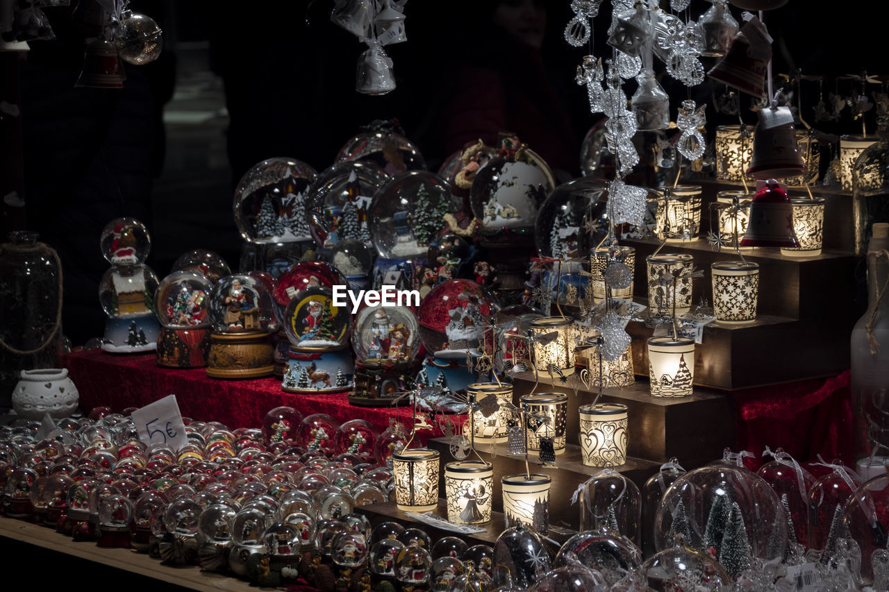 choice, variation, large group of objects, abundance, for sale, arrangement, retail, market, collection, indoors, art and craft, retail display, container, human representation, no people, order, representation, market stall, sale, religion, altar, antique