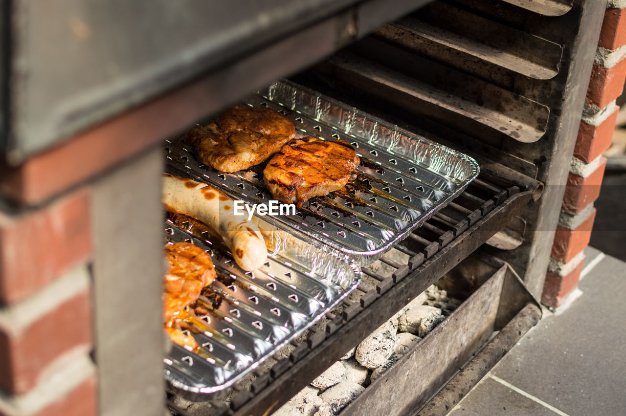 High angle view of meat cooking in oven