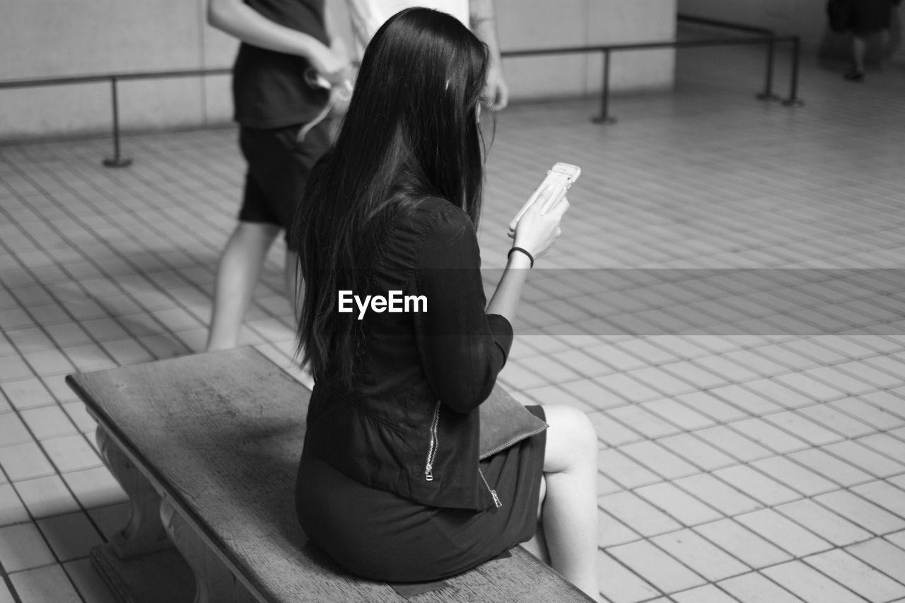 Woman Using Smart Phone At British Museum