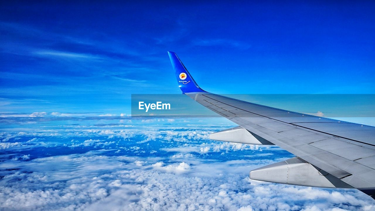 airplane, sky, aerial view, journey, nature, transportation, beauty in nature, tranquil scene, cloud - sky, blue, scenics, airplane wing, travel, no people, mode of transport, tranquility, day, aircraft wing, flying, outdoors, landscape, cold temperature