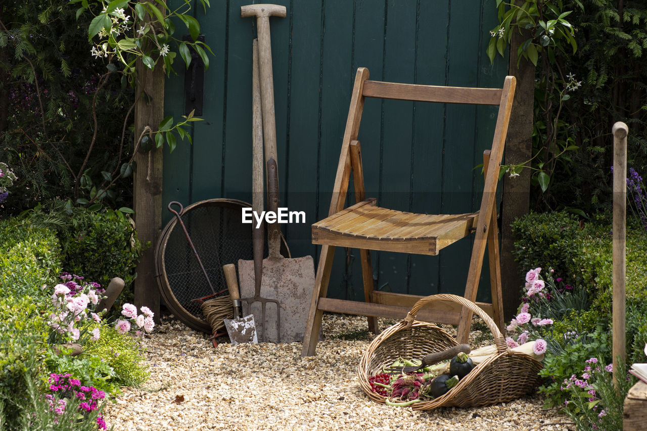 POTTED PLANTS IN BASKET ON TABLE BY YARD