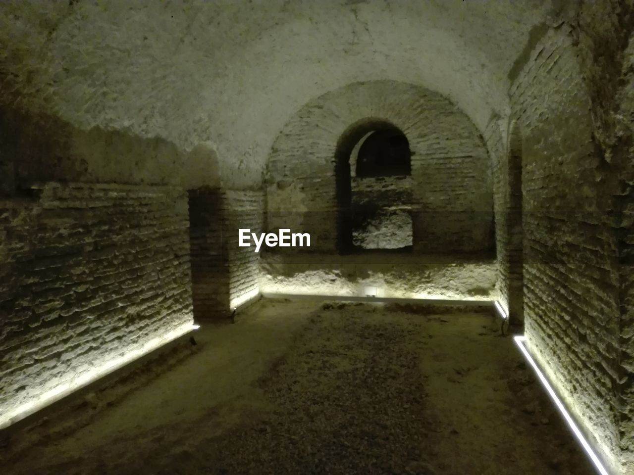 arch, architecture, built structure, history, indoors, old ruin, day, castle, cellar, no people, prison, basement