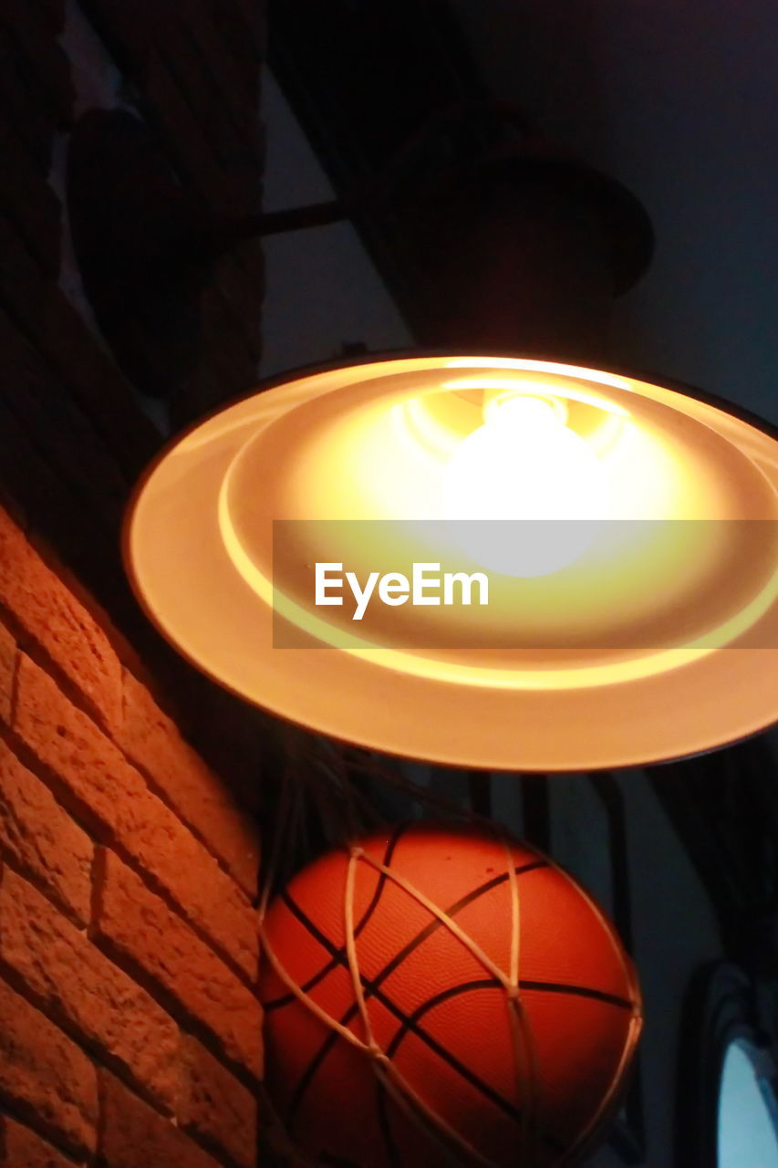 illuminated, lighting equipment, indoors, close-up, glowing, no people, focus on foreground, electricity, light, electric lamp, electric light, light - natural phenomenon, light bulb, technology, lamp shade, low angle view, wood - material, pendant light, yellow, heat - temperature, ceiling