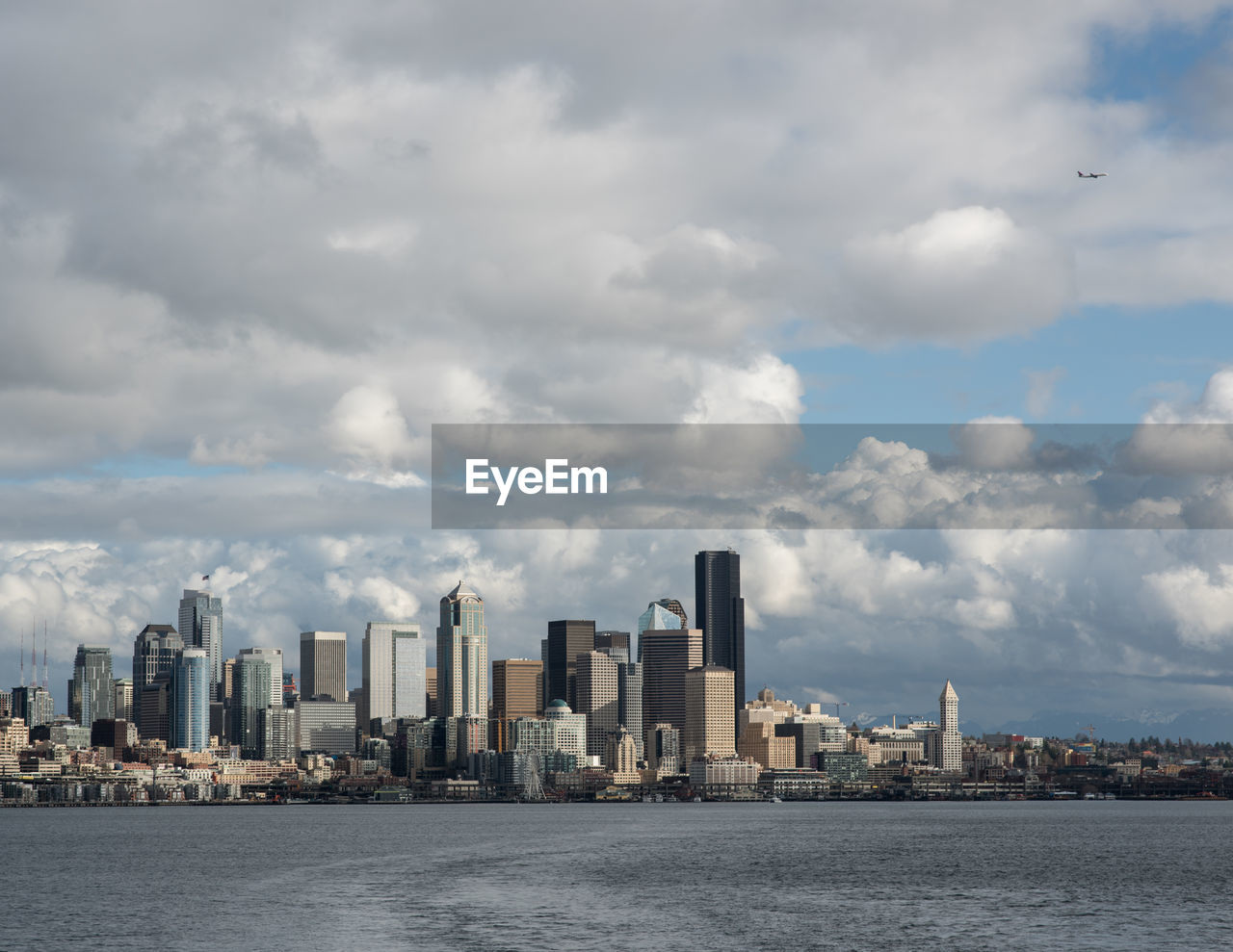 skyscraper, city, cityscape, architecture, sky, building exterior, built structure, cloud - sky, urban skyline, waterfront, downtown district, modern, financial district, day, city life, no people, outdoors, sea, water
