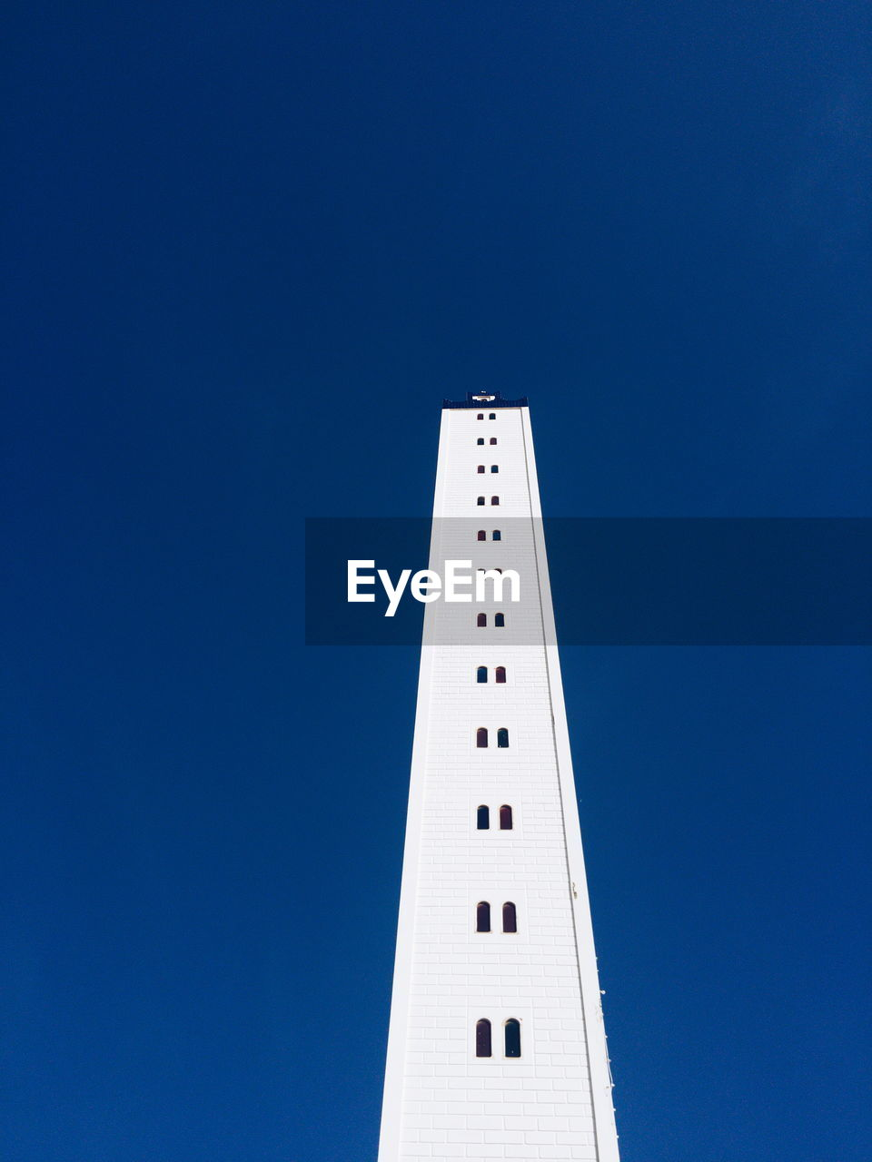 copy space, clear sky, low angle view, blue, architecture, built structure, no people, day, building exterior, outdoors, sky
