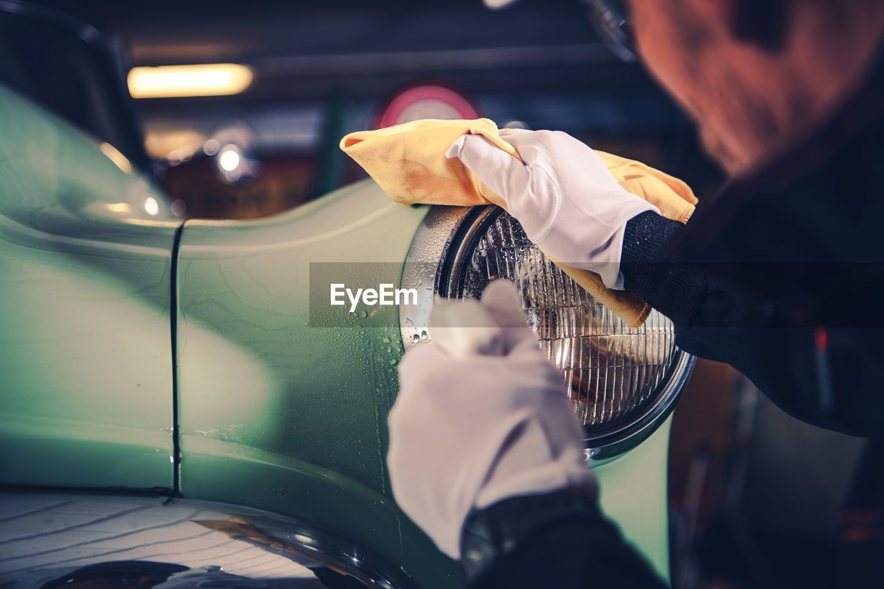 Cropped Image Of Man Cleaning Car