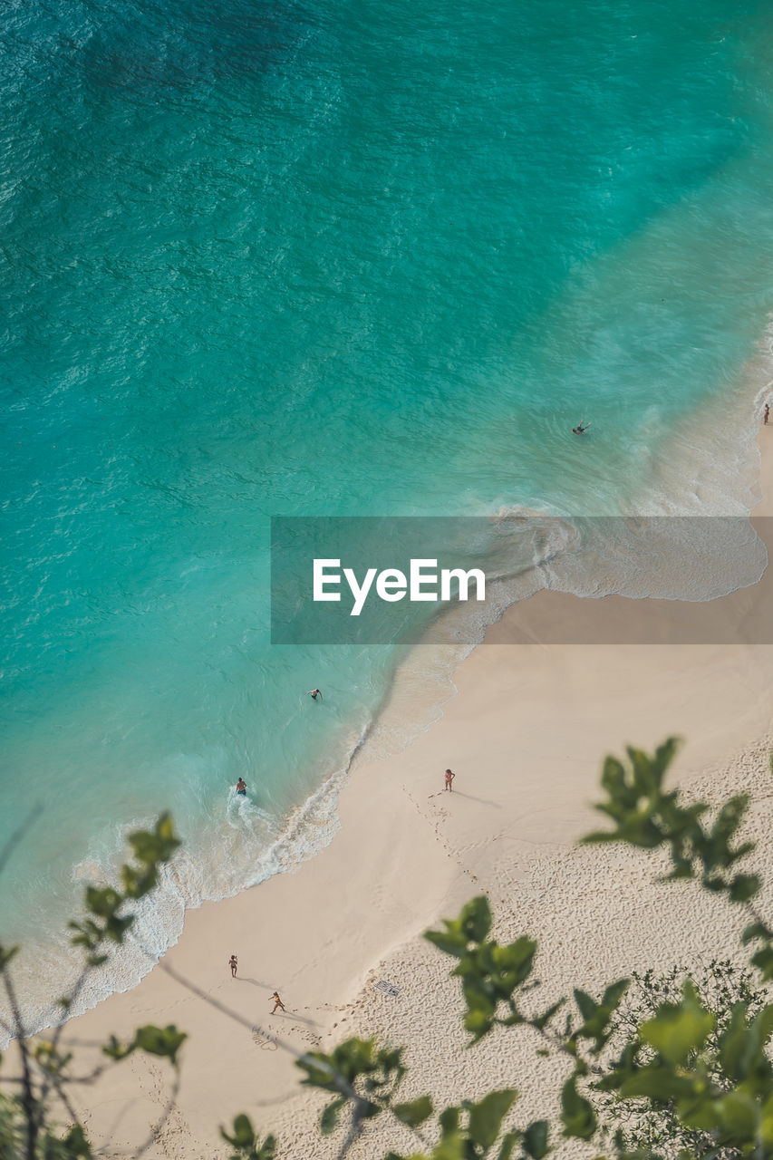 land, water, sea, sand, beach, beauty in nature, high angle view, nature, day, tranquility, scenics - nature, tranquil scene, motion, outdoors, no people, wave, idyllic, sunlight, turquoise colored