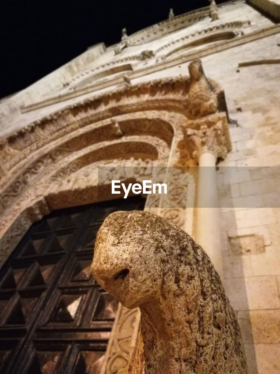 architecture, history, low angle view, built structure, religion, place of worship, spirituality, sculpture, statue, ancient civilization, no people, ancient, travel destinations, building exterior, gargoyle, outdoors, night, close-up, sky