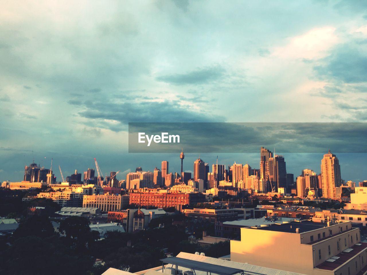 cityscape, cloud - sky, architecture, building exterior, sky, skyscraper, city, built structure, no people, outdoors, urban skyline, day