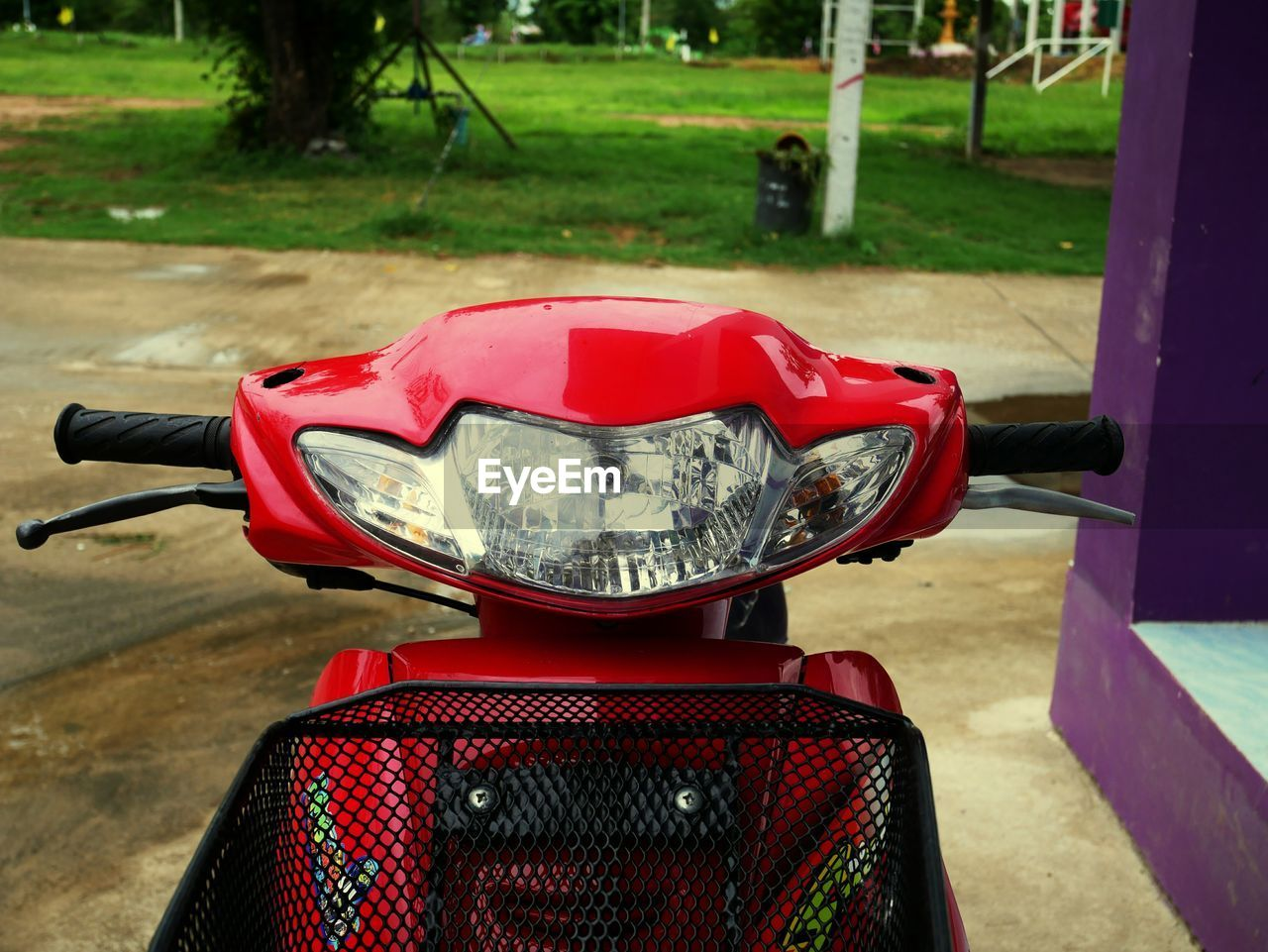 red, day, transportation, land vehicle, mode of transportation, focus on foreground, close-up, no people, rear view, playground, bicycle, motor scooter, outdoors, nature, scooter, motorcycle, metal, helmet, handlebar, city