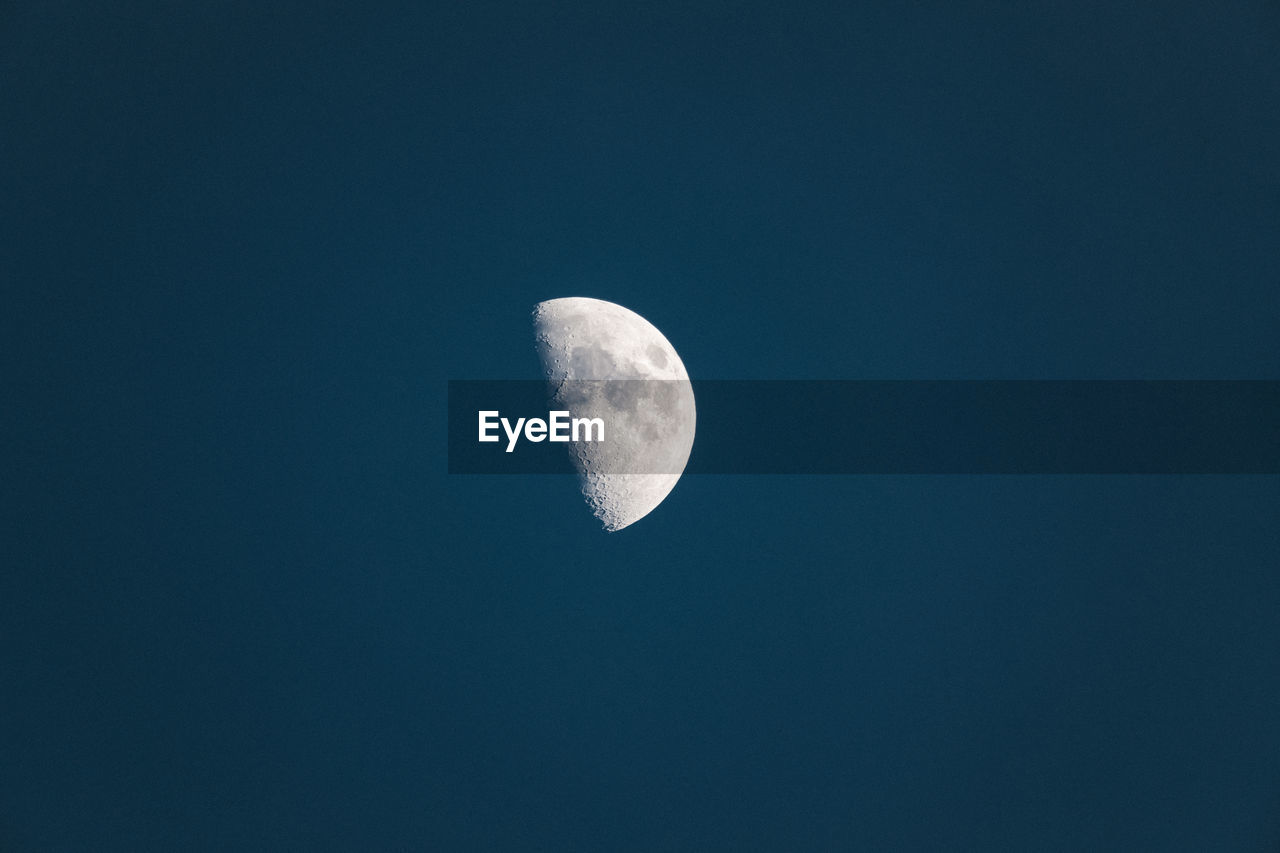 LOW ANGLE VIEW OF MOON AGAINST CLEAR SKY