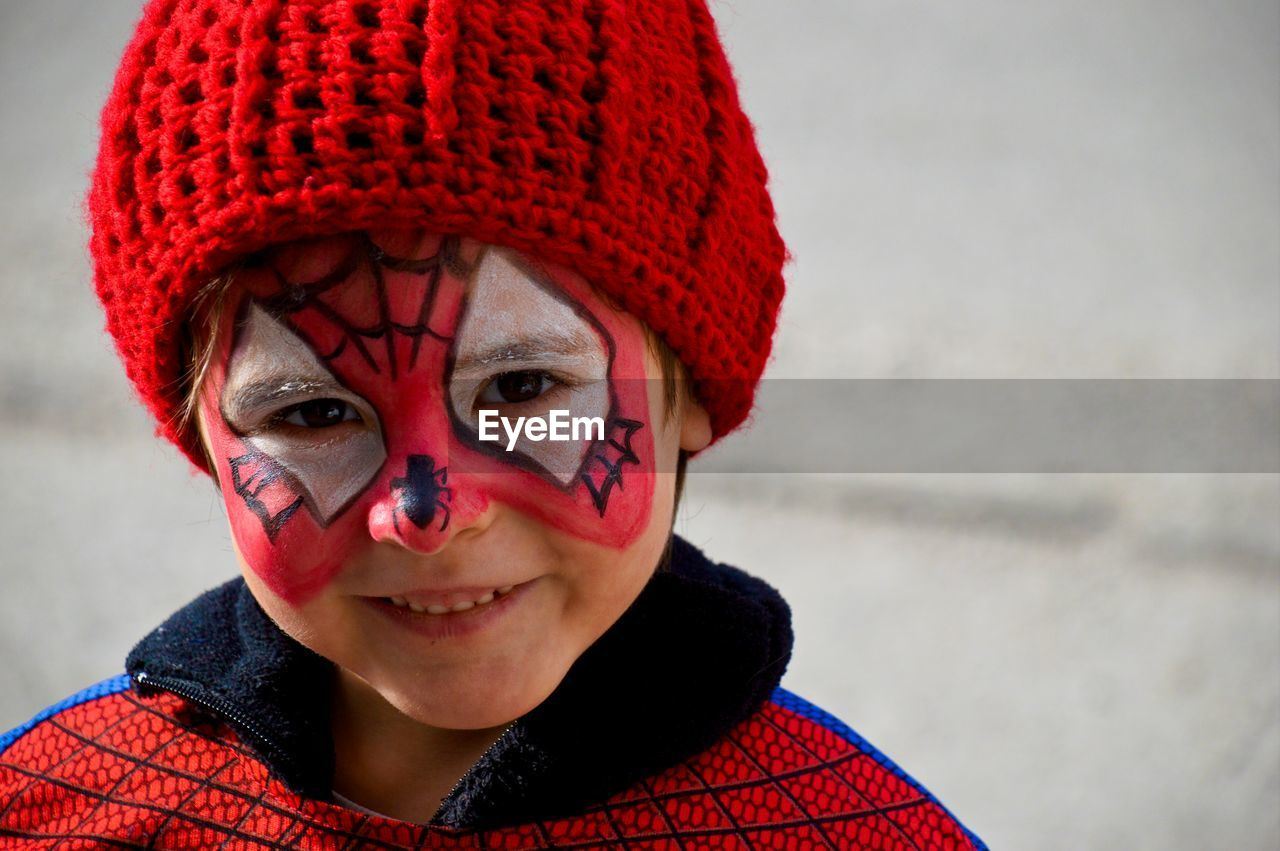 Close-up portrait of girl in superhero costume at carnival