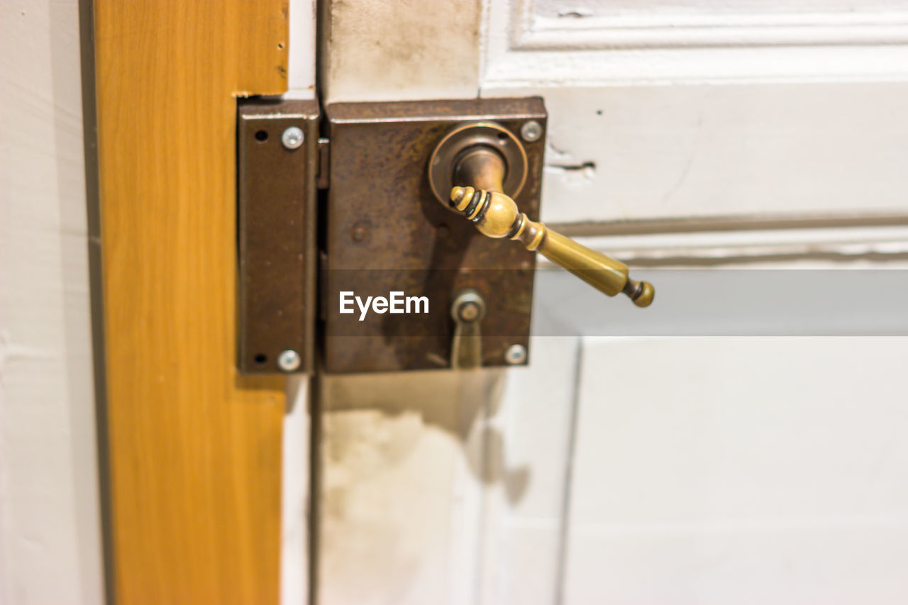 door, metal, entrance, close-up, no people, safety, security, protection, lock, day, indoors, handle, wood - material, knob, doorknob, closed, white color, selective focus, focus on foreground, latch, silver colored