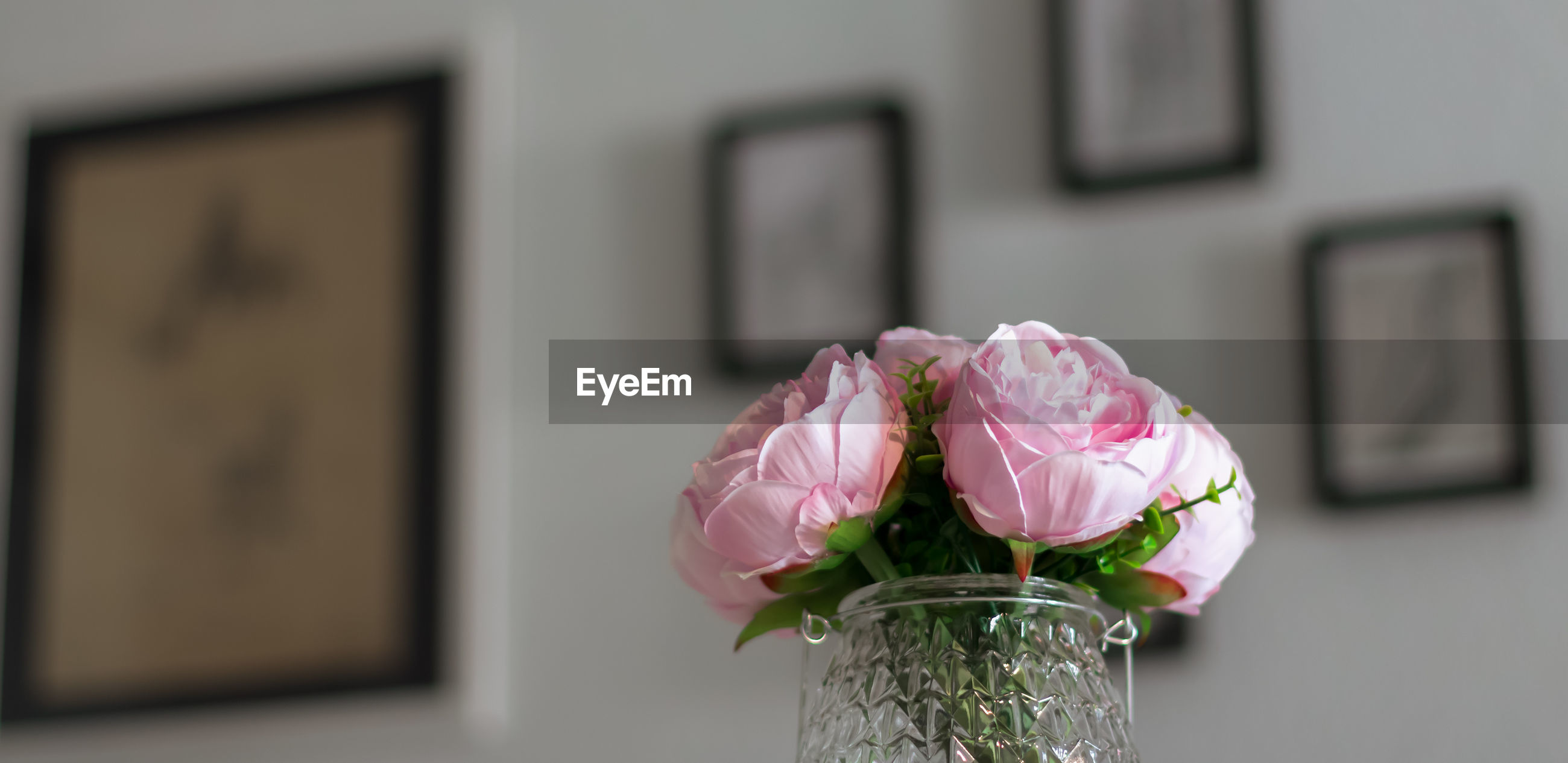 Low level angle of a artificial bouquet of flowers for interiors. slightly warm light over them.