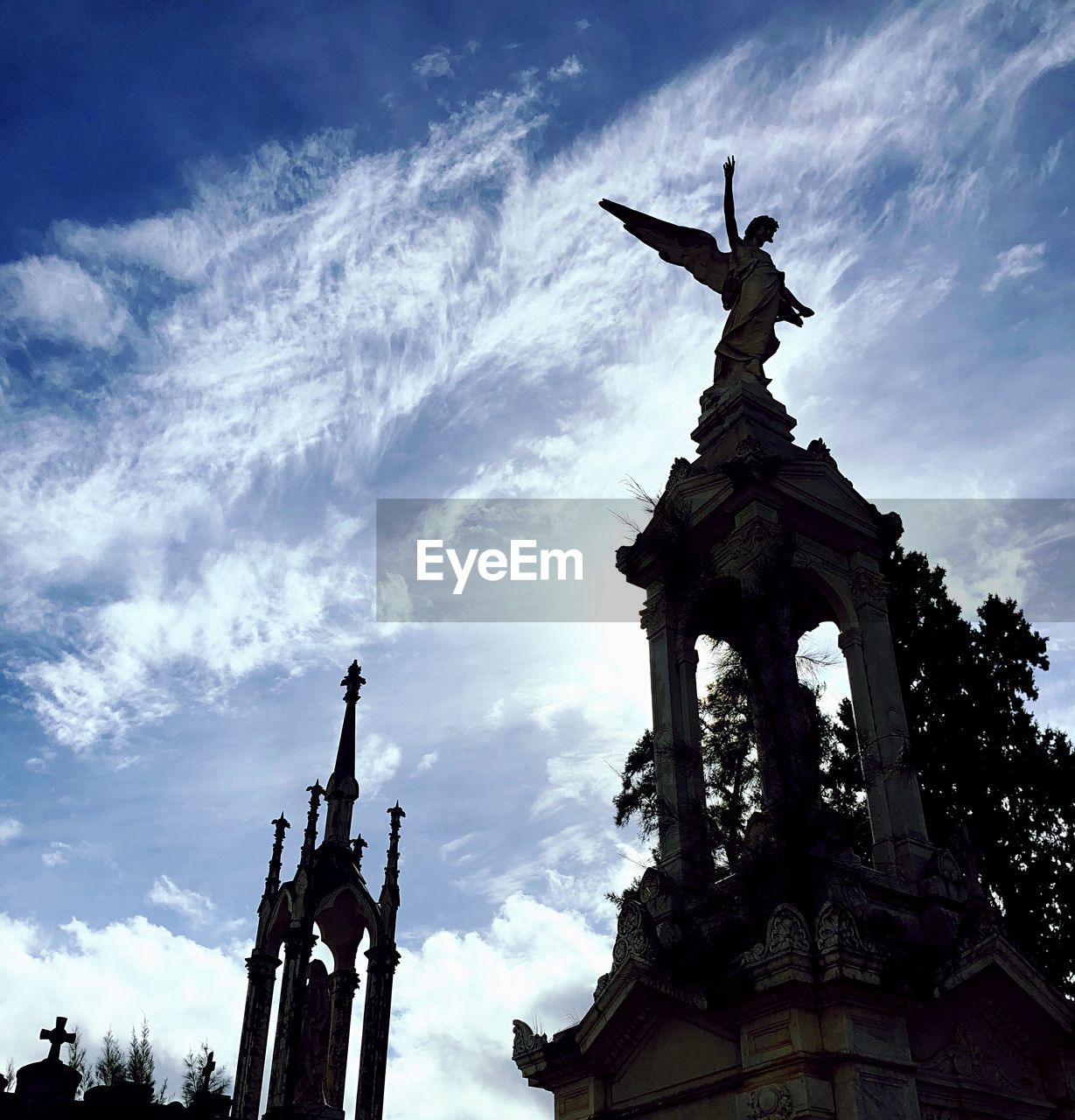 sculpture, low angle view, sky, statue, cloud - sky, art and craft, architecture, representation, human representation, built structure, creativity, the past, no people, history, nature, craft, male likeness, travel destinations, religion, outdoors, angel, architectural column