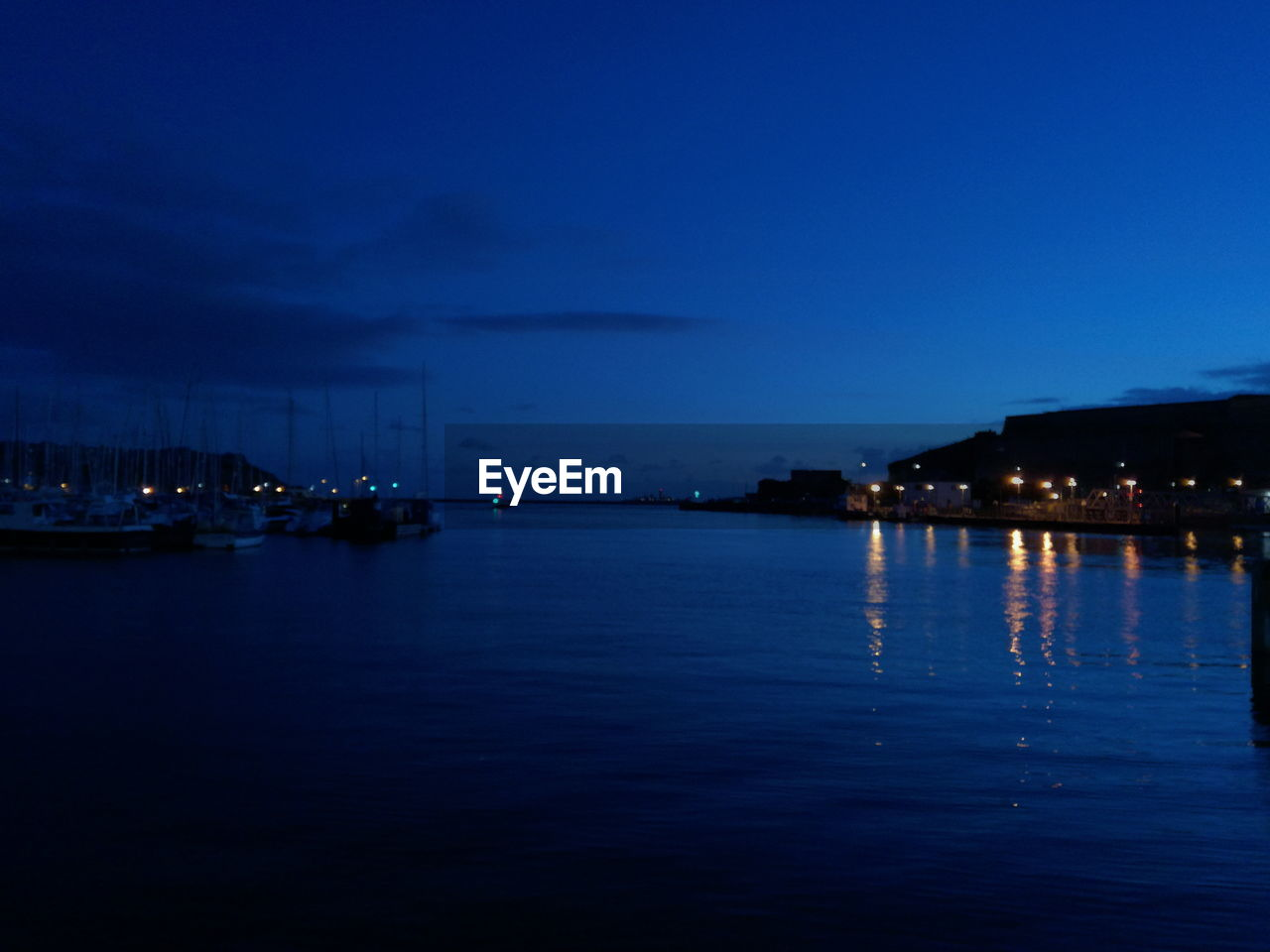 night, illuminated, water, blue, architecture, no people, sky, built structure, nautical vessel, building exterior, outdoors, transportation, tranquility, sea, nature, beauty in nature, harbor, travel destinations, yacht, scenics, city