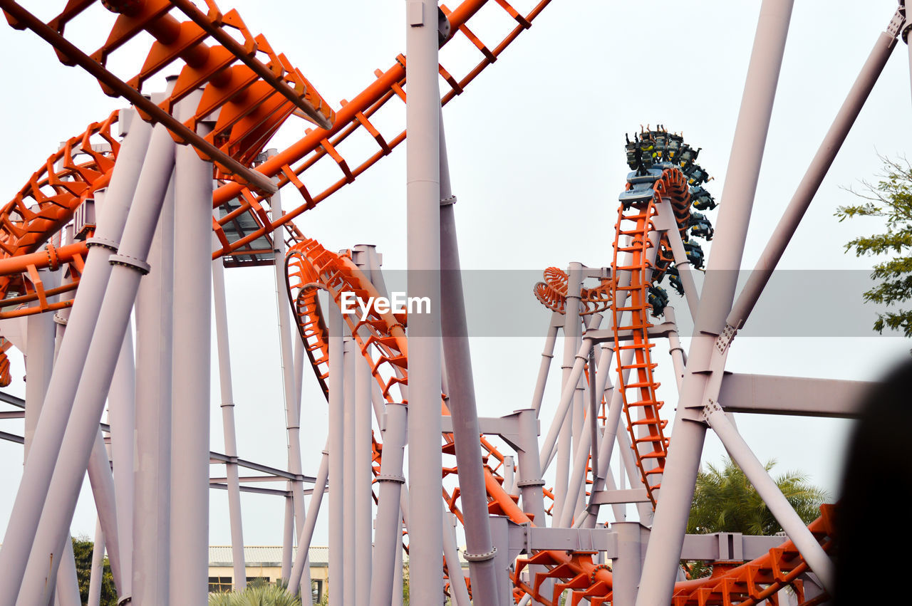 Low Angle View Of Rollercoaster Ride Against Clear Sky