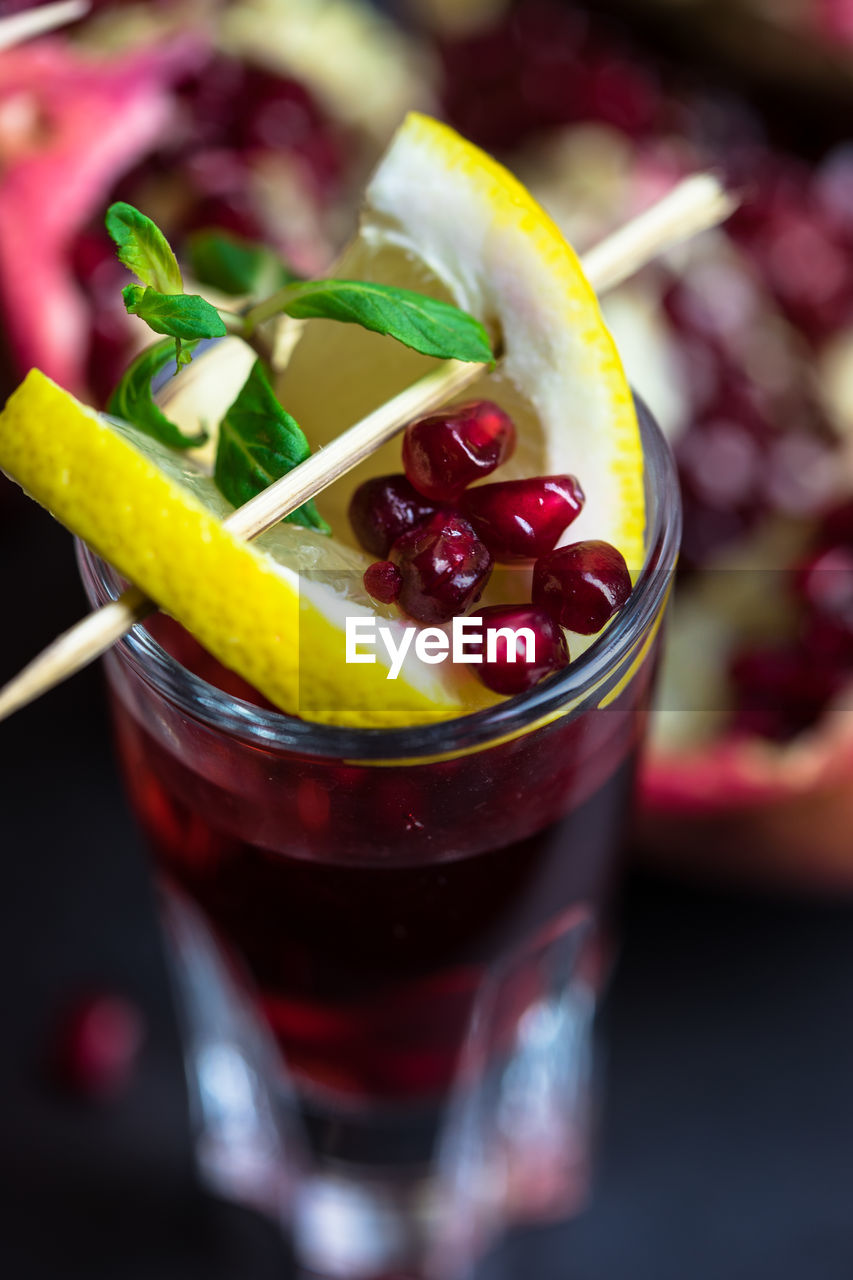 Pomegranate juice decorated with slices of lemon and mint