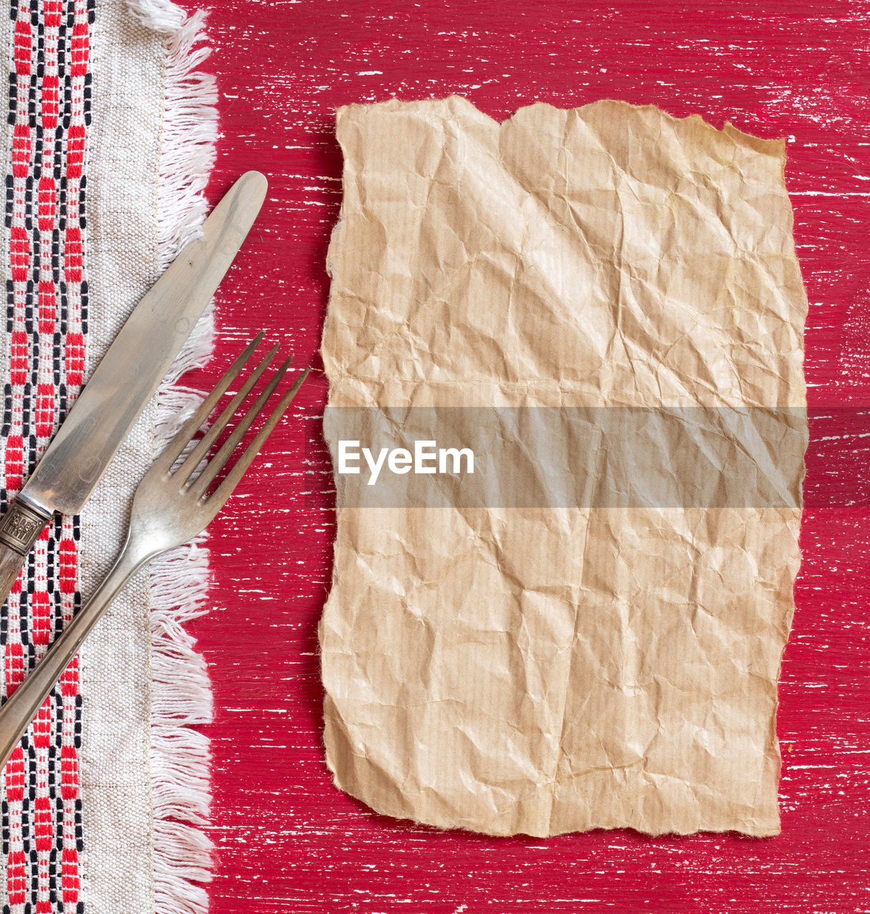food and drink, food, indoors, table, high angle view, directly above, still life, no people, red, freshness, kitchen utensil, close-up, paper, tablecloth, textile, eating utensil, fork, pattern, studio shot, ready-to-eat, table knife
