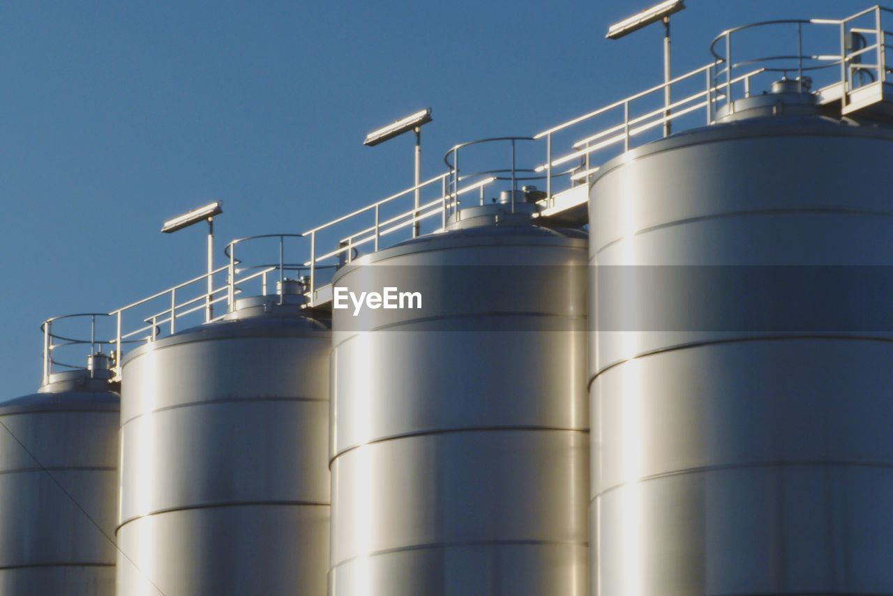 factory, industry, metal, no people, sky, low angle view, business, nature, technology, silver colored, manufacturing, storage tank, outdoors, silo, cylinder, blue, steel, container, clear sky, built structure, alloy, industrial equipment