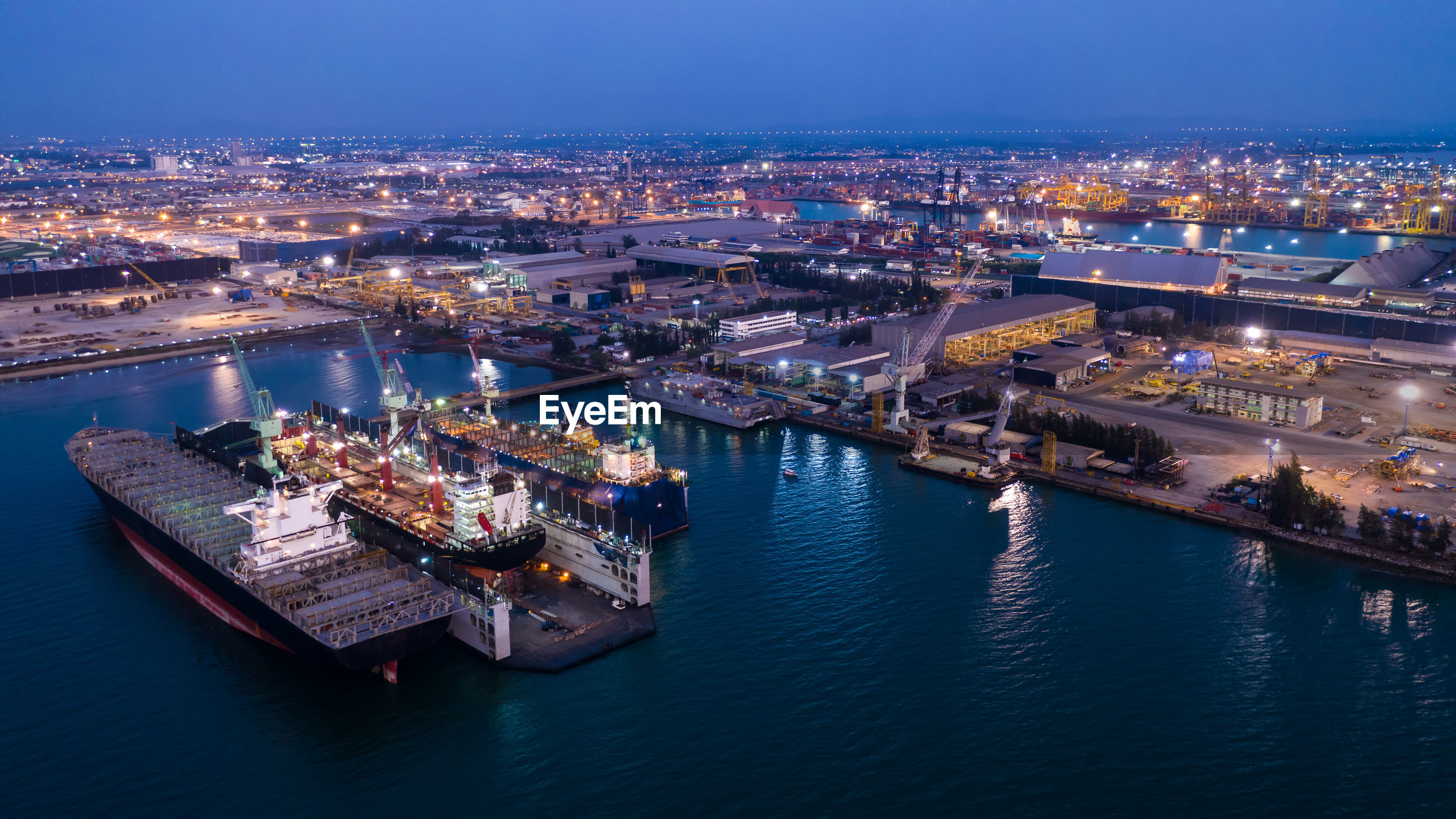 High angle view of shipping containers port illuminated  at night