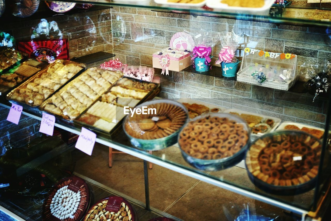 food, food and drink, retail, for sale, sweet food, variation, store, indulgence, indoors, dessert, freshness, temptation, choice, bakery, no people, unhealthy eating, price tag, ready-to-eat, ice cream parlor, day, close-up