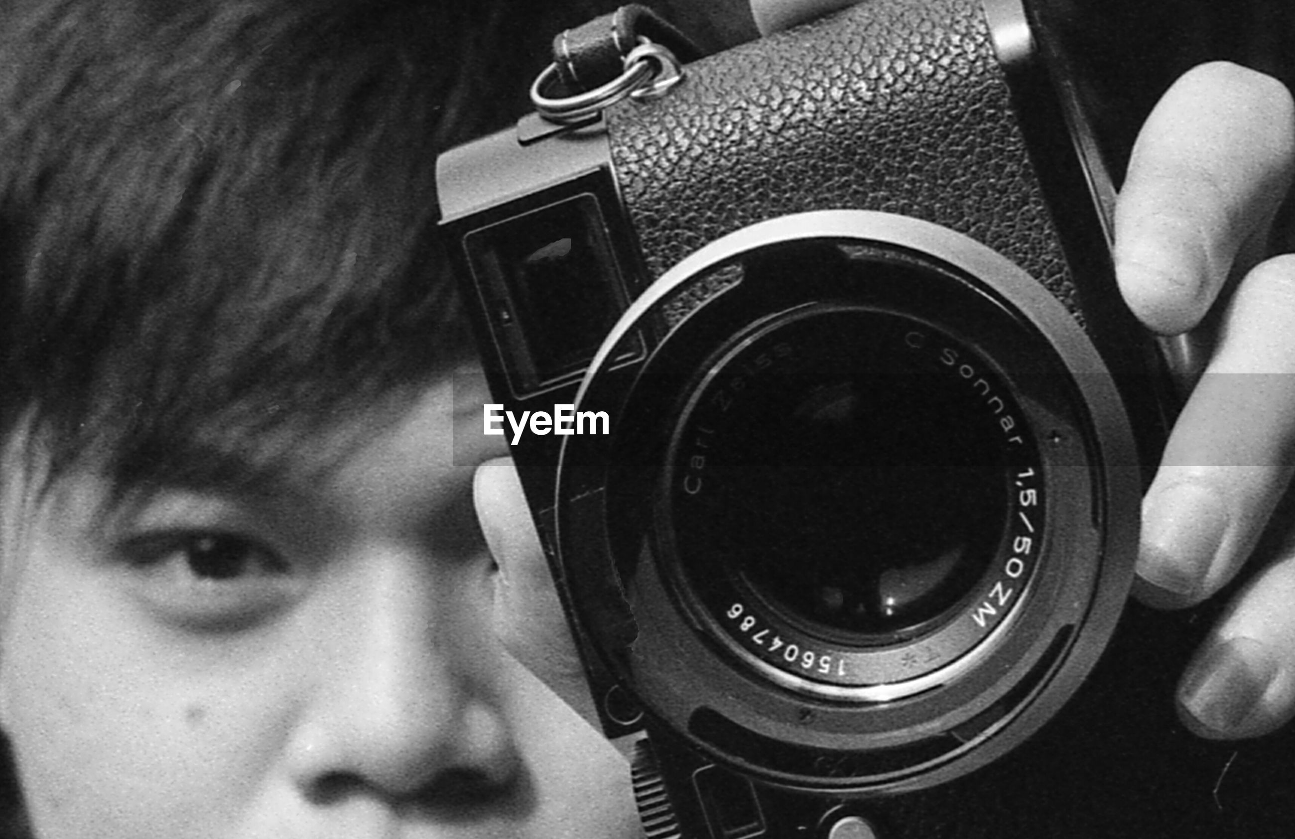 indoors, technology, photography themes, close-up, holding, person, part of, camera - photographic equipment, photographing, wireless technology, lifestyles, cropped, focus on foreground, digital camera, men, leisure activity, unrecognizable person