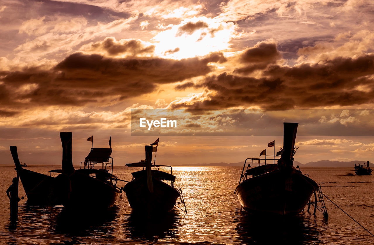 sunset, nautical vessel, transportation, mode of transportation, sky, cloud - sky, sea, water, beauty in nature, scenics - nature, orange color, waterfront, nature, moored, no people, tranquility, silhouette, tranquil scene, idyllic, outdoors, fishing boat