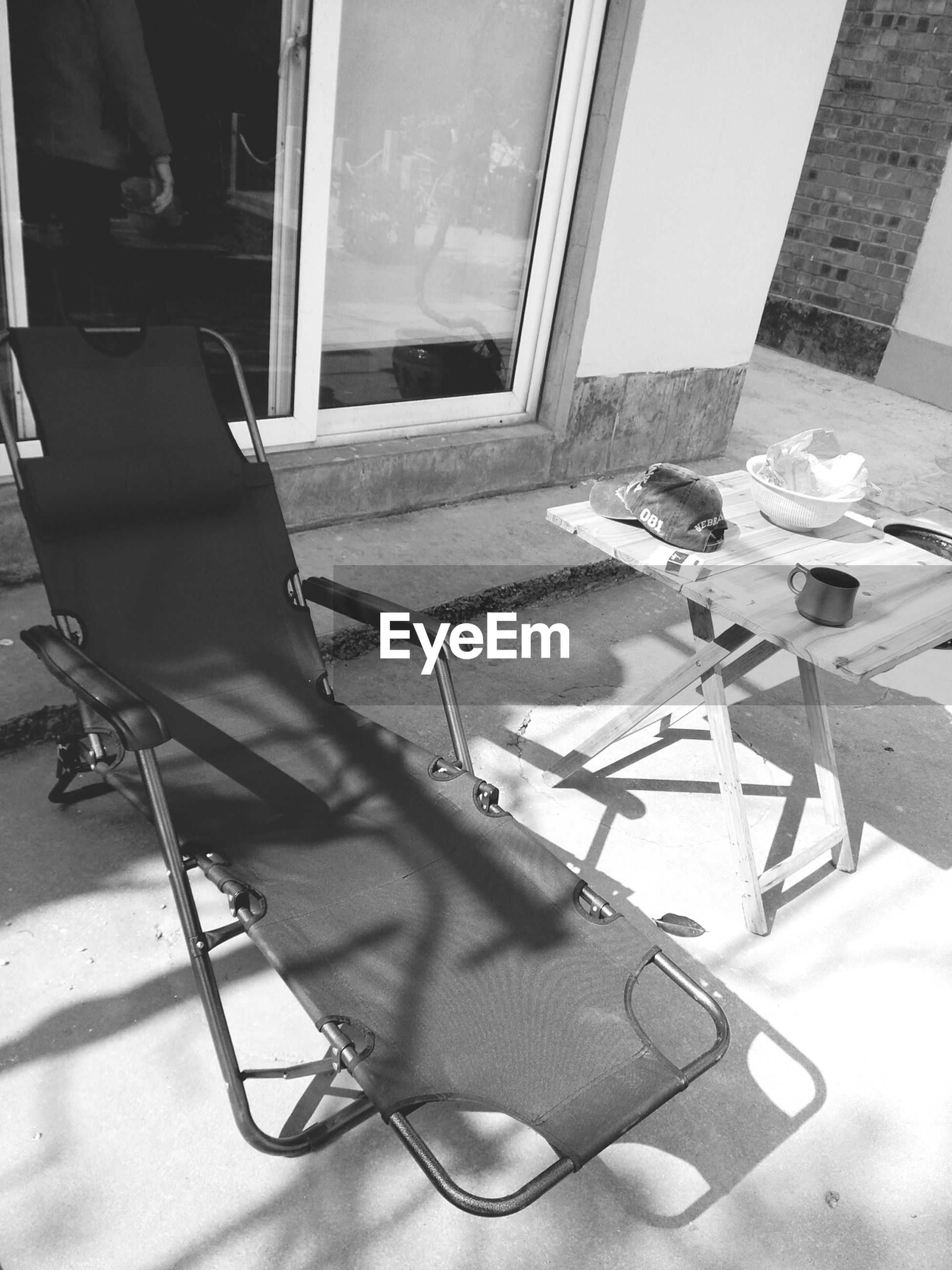 indoors, chair, window, built structure, architecture, home interior, absence, table, empty, sunlight, house, day, high angle view, flooring, shadow, no people, door, building exterior, domestic room, glass - material
