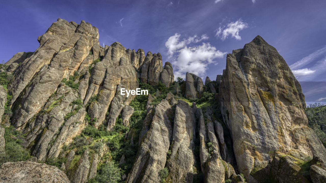 rock, sky, rock - object, solid, beauty in nature, rock formation, mountain, low angle view, scenics - nature, cloud - sky, nature, tranquility, tranquil scene, physical geography, geology, no people, mountain range, non-urban scene, land, day, formation, outdoors, mountain peak, eroded, arid climate