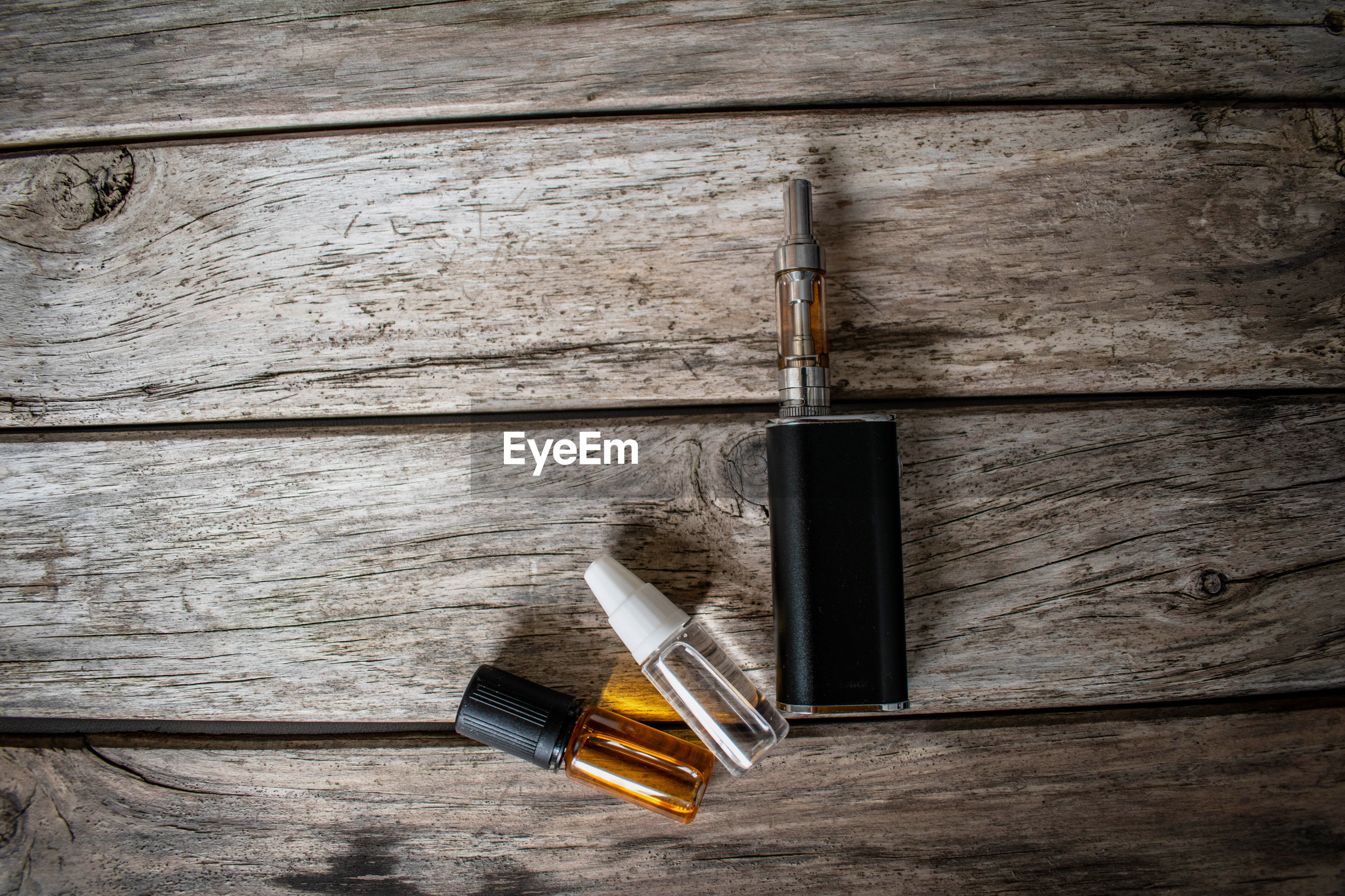 Directly above shot of electronic cigarette on table