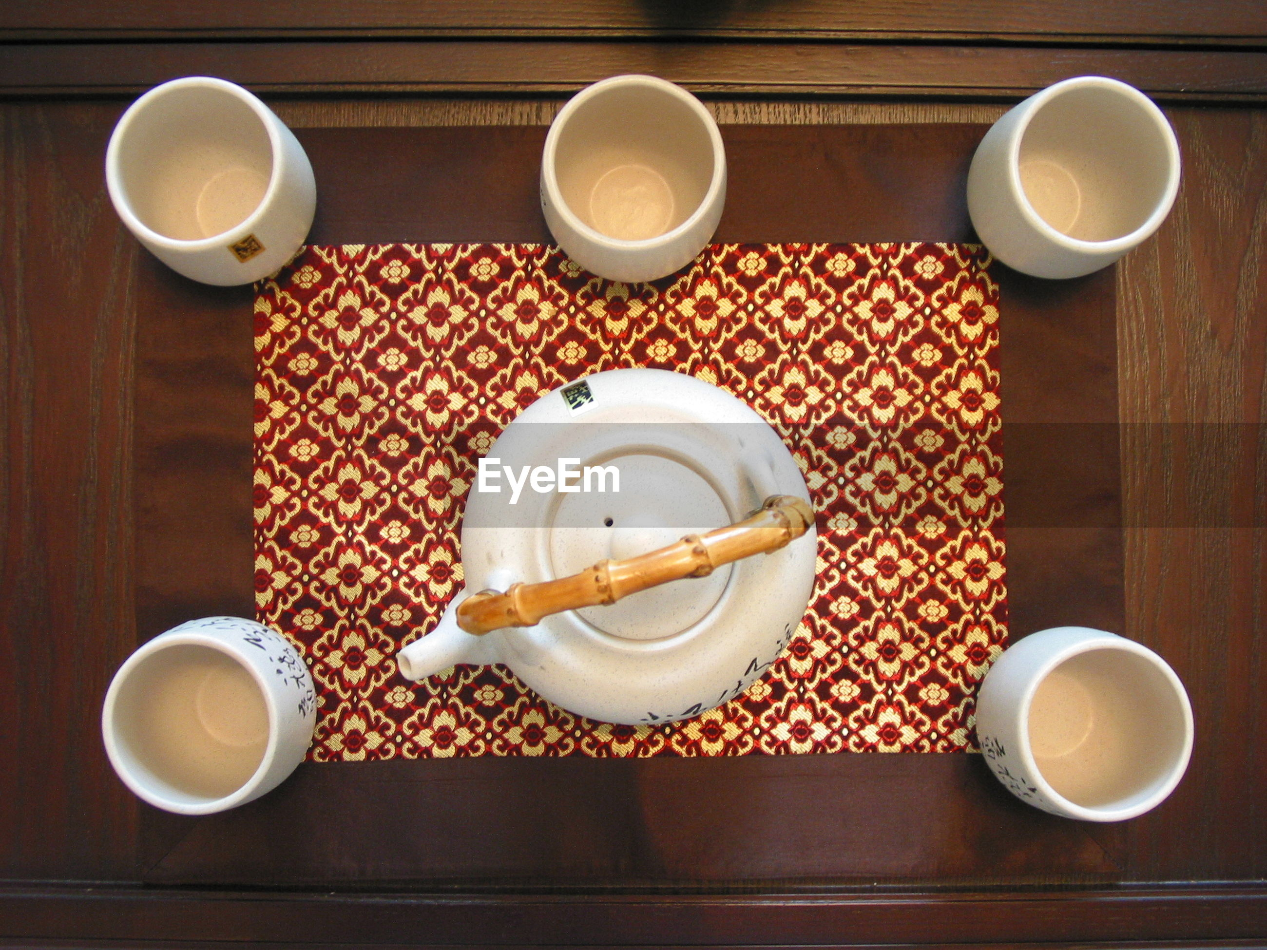 HIGH ANGLE VIEW OF TEA CUP ON TABLE WITH SPOON